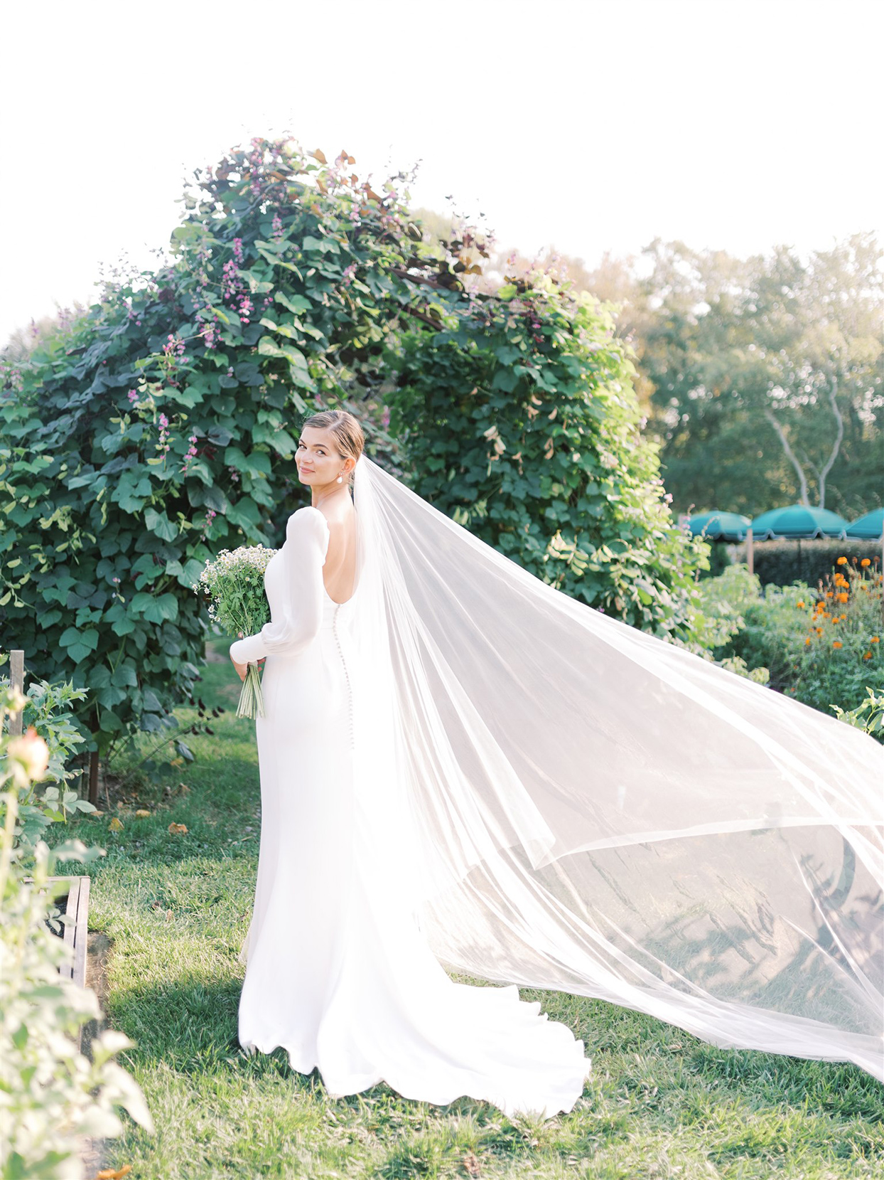 samantha cody wedding bride in white dress and veil flowing in the wind