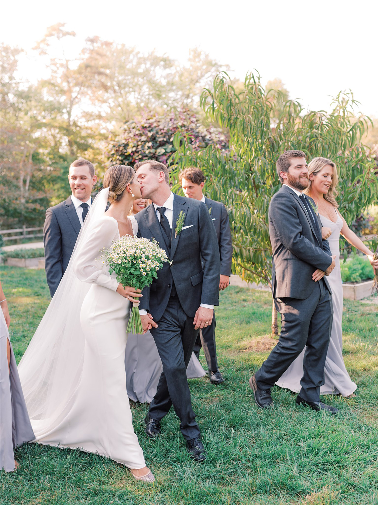 samantha cody wedding couple kissing and walking with party