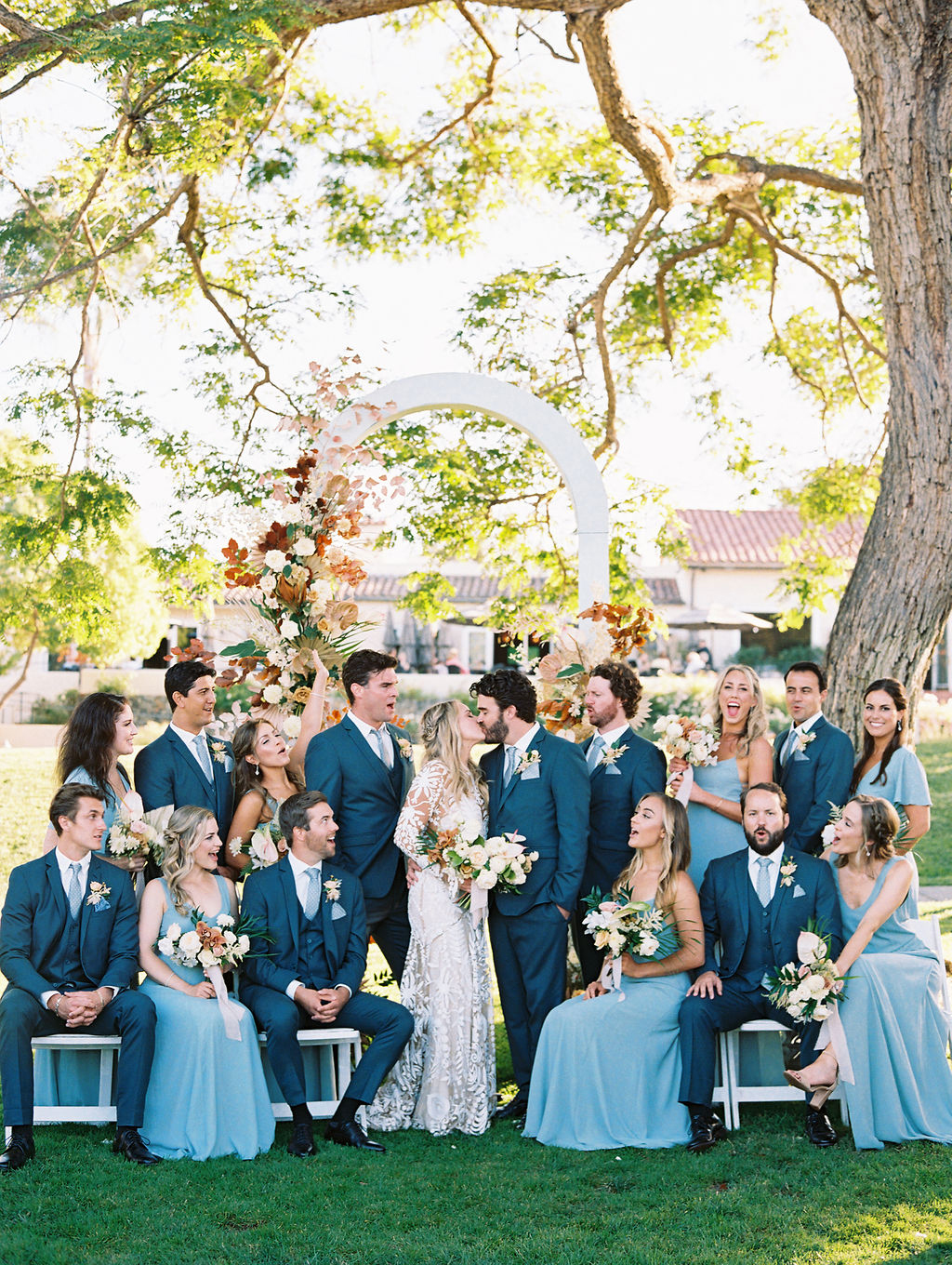 sara trisdan wedding party in blue on sunny lawn