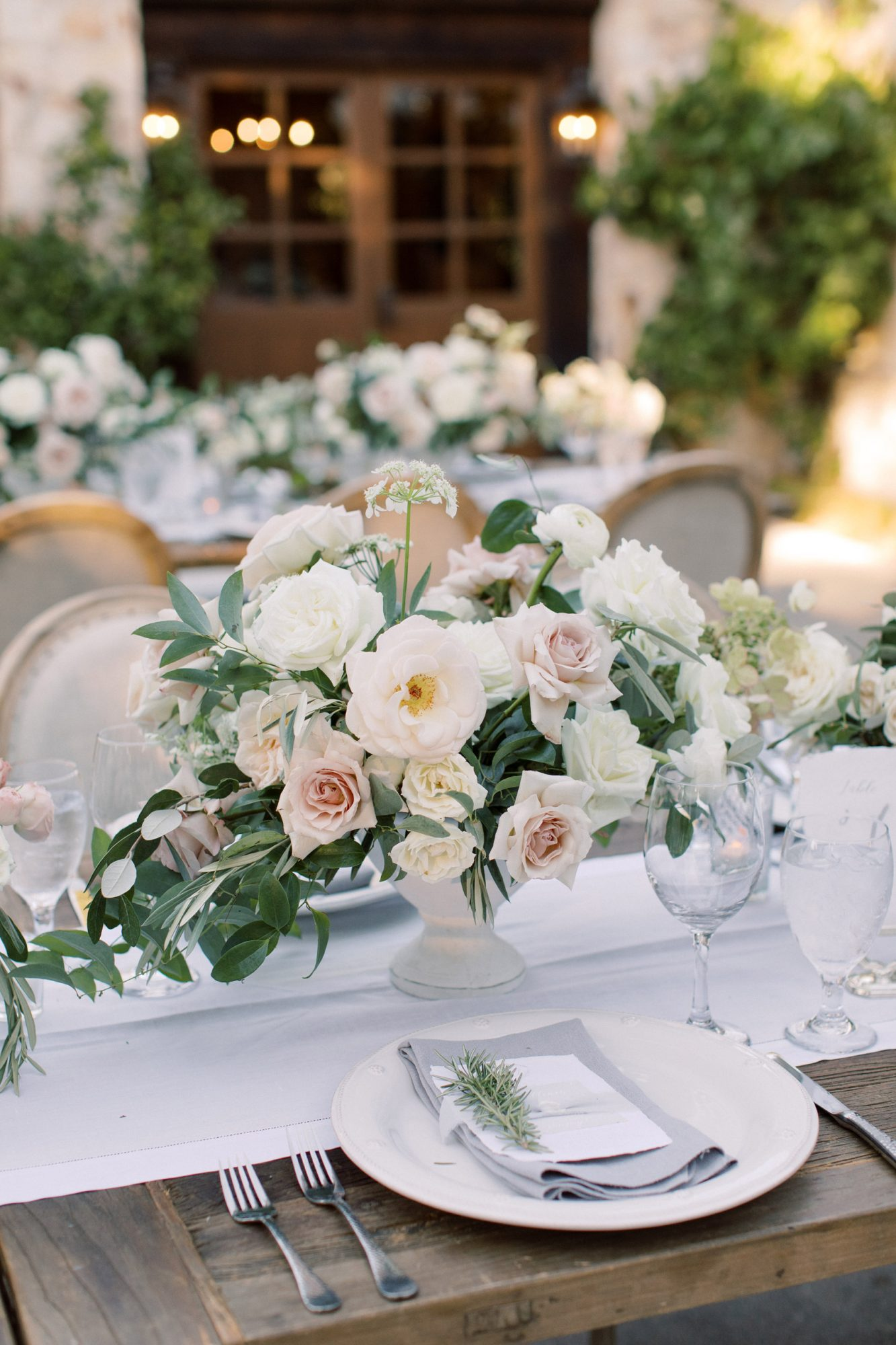 wedding place settings and floral centerpiece
