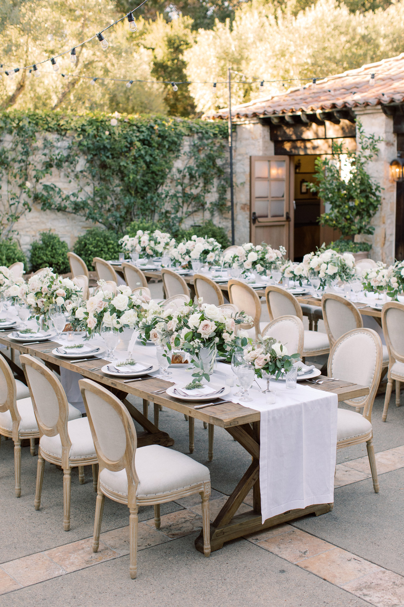 reception tables with floral centerpieces and place settings