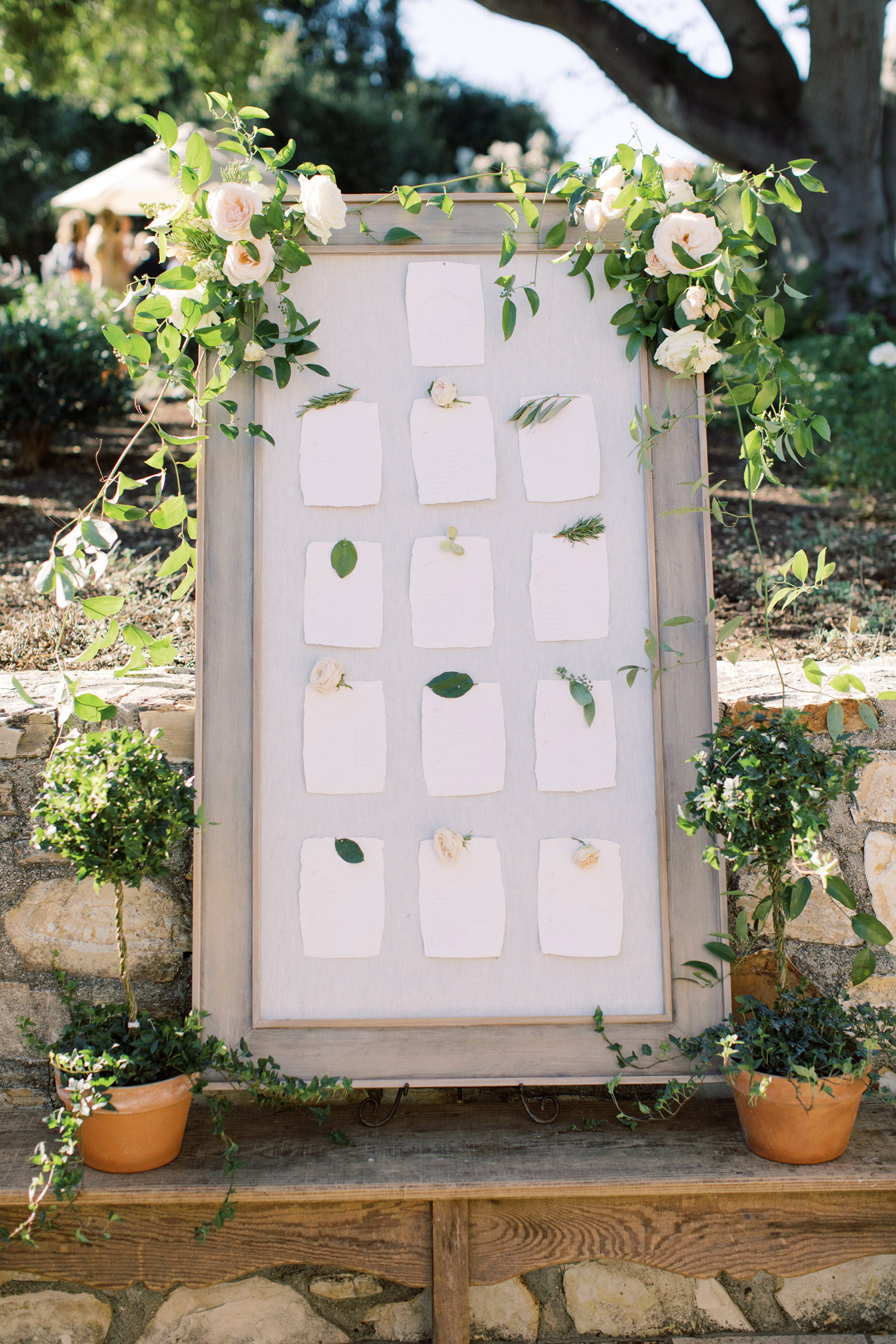 outdoor wood framed wedding seating chart