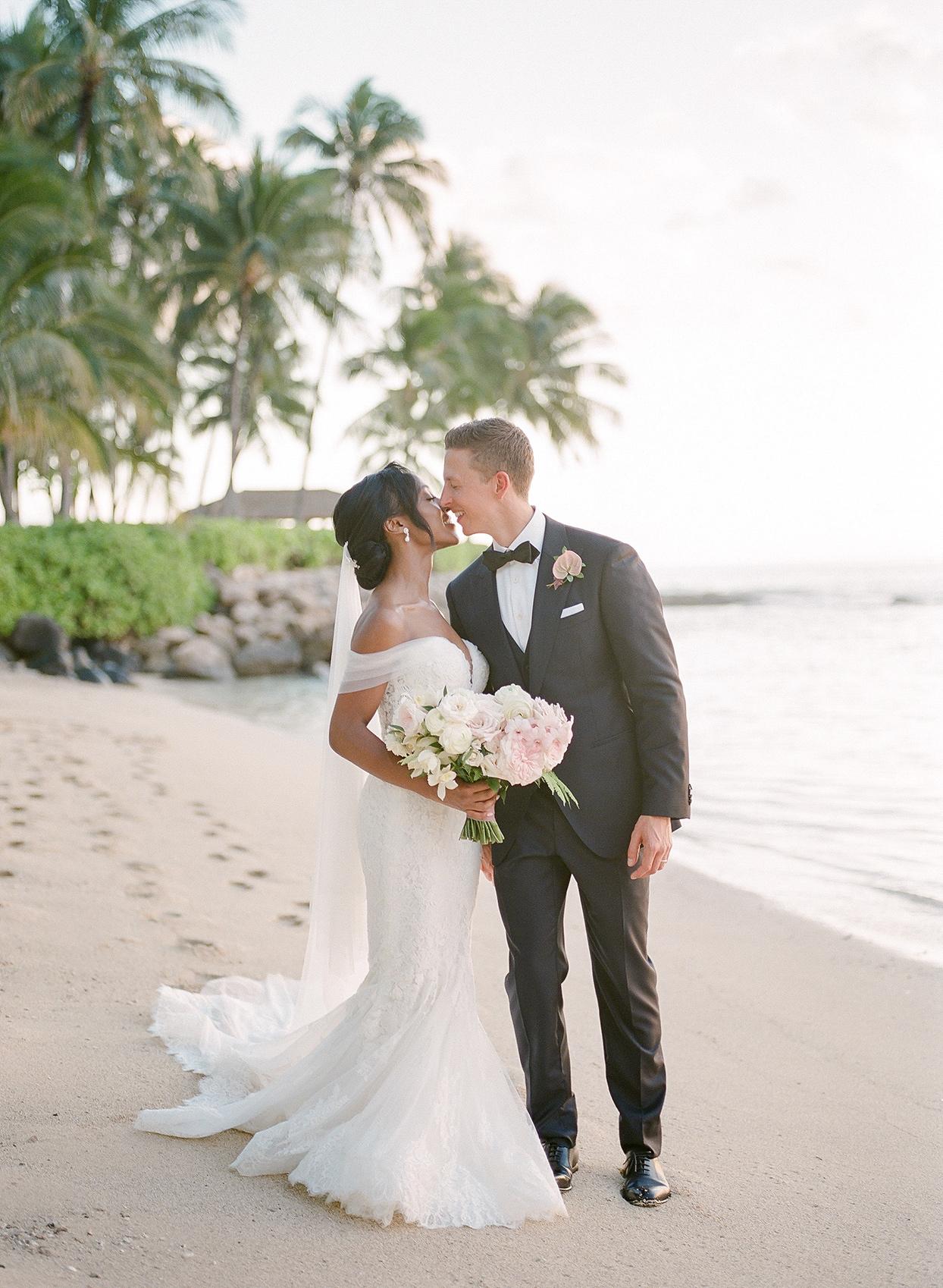 vanessa nathan wedding couple kissing on the beach