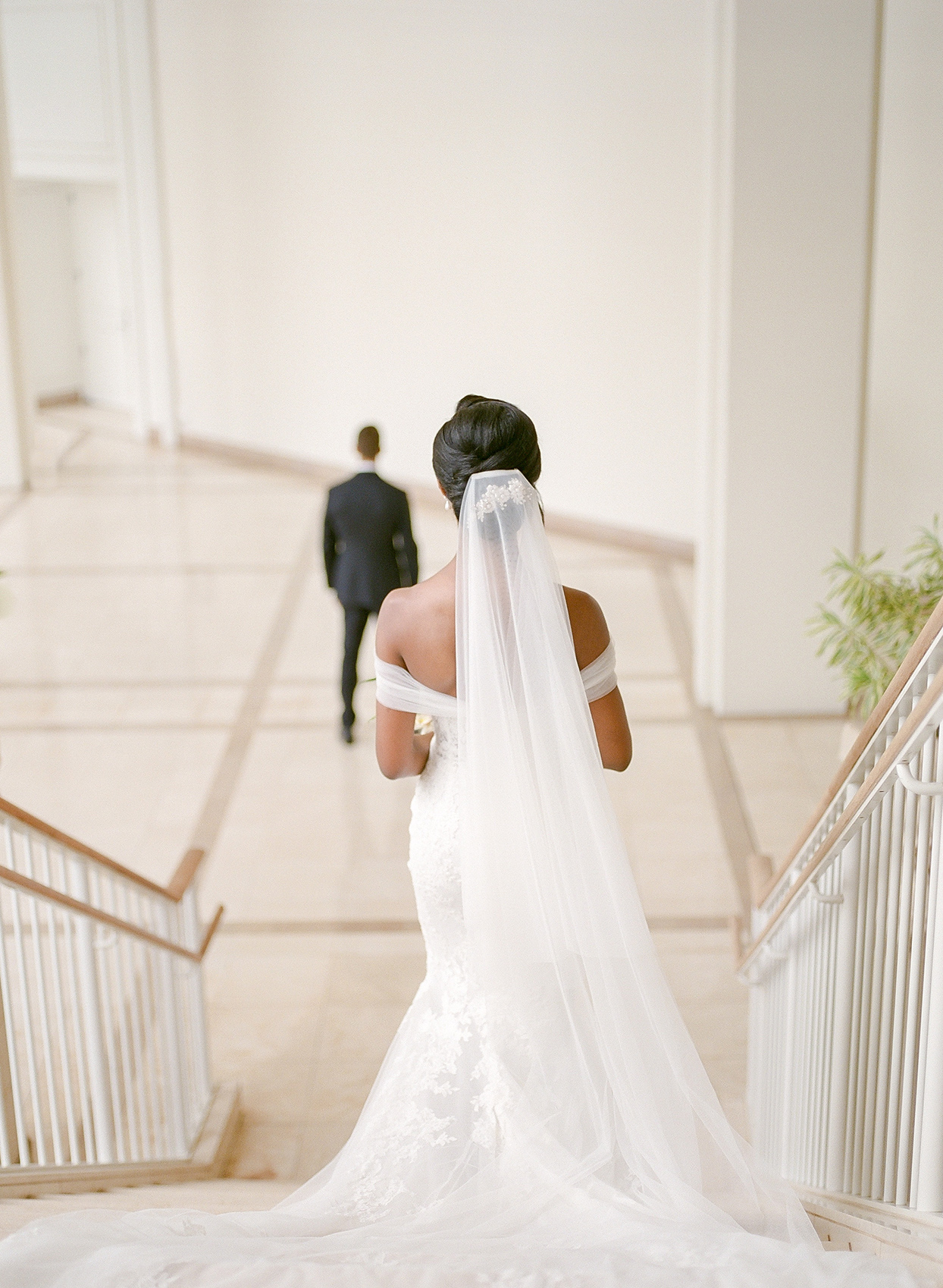 bride walking down stairs to meet groom for first look