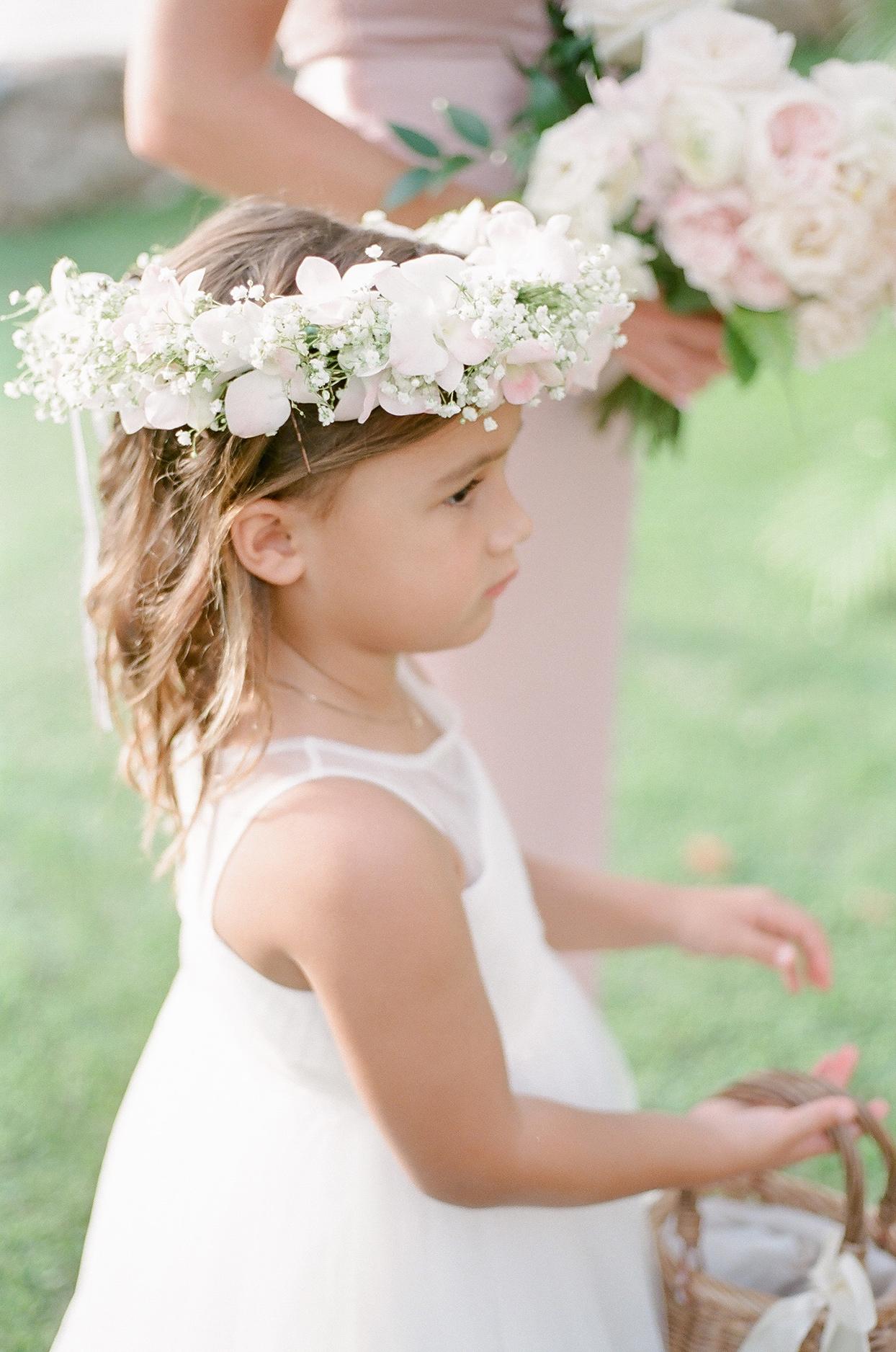vanessa nathan wedding flower girl wearing white wreath in hair