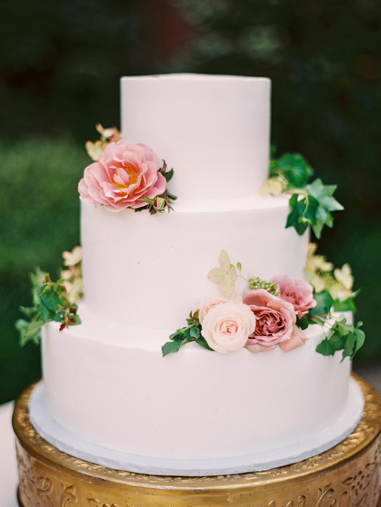yalda anusha white three tiered wedding cake with pink roses