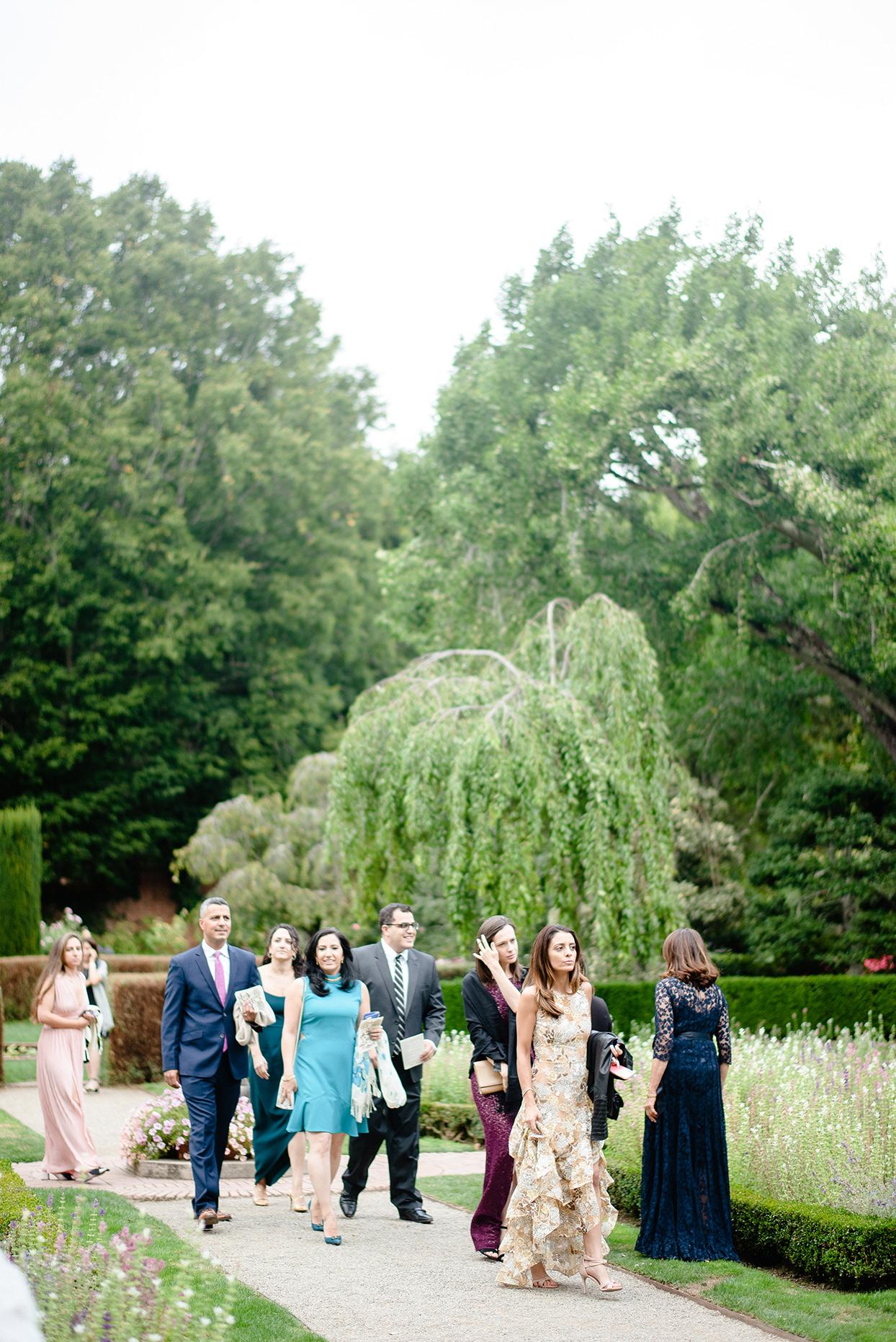 yalda anusha wedding guests walking in garden