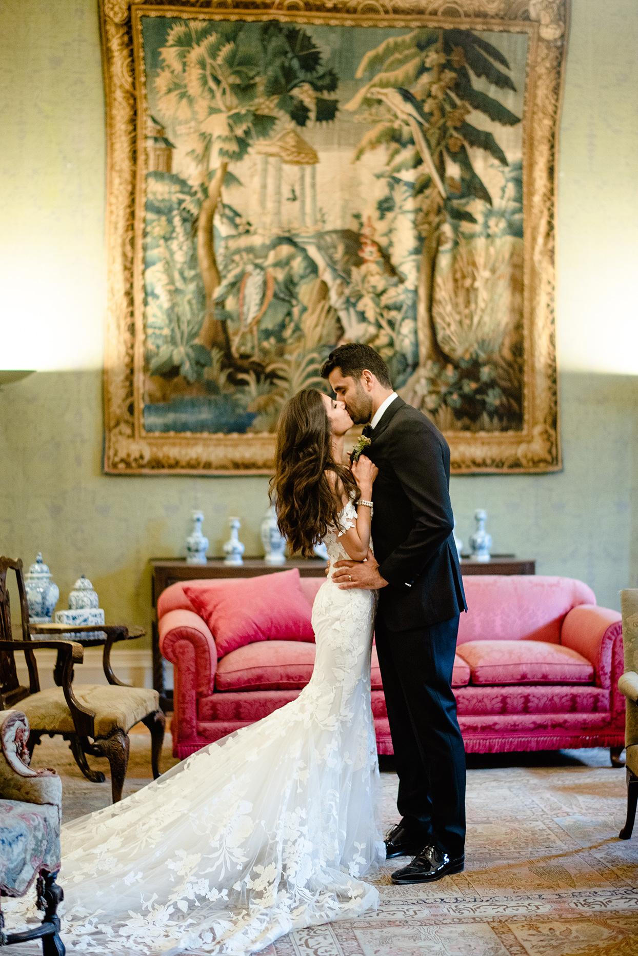 yalda anusha wedding couple kissing in front of antique painting