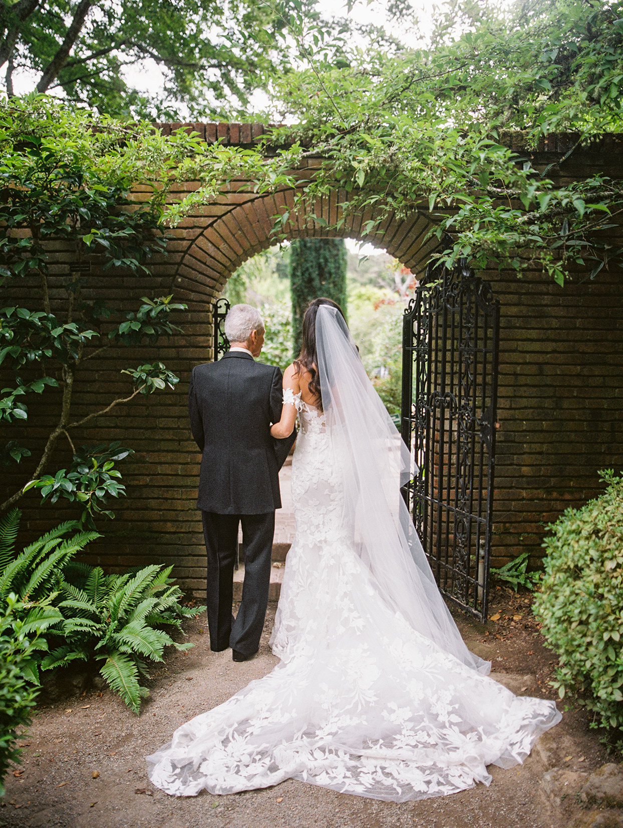 yalda anusha wedding bride and father walking through garden gate