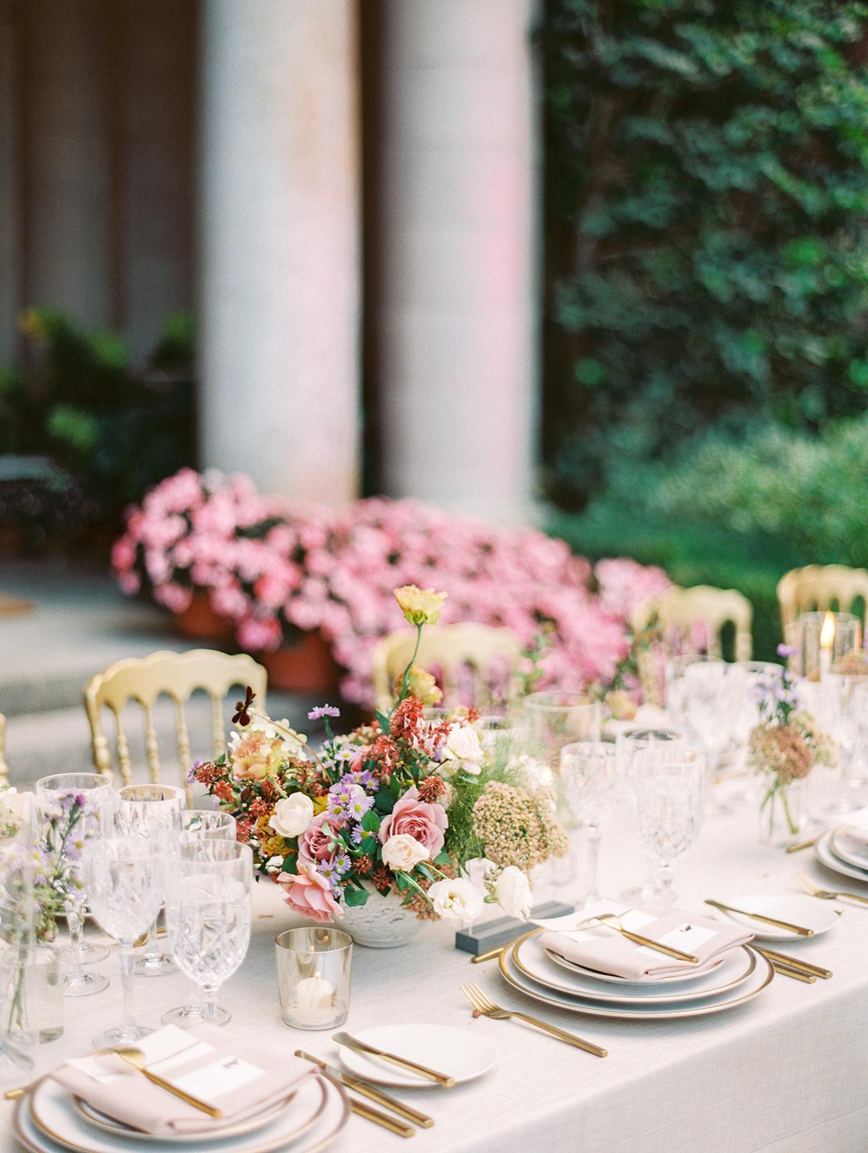 yalda anusha wedding reception table with pink hues floral centerpiece