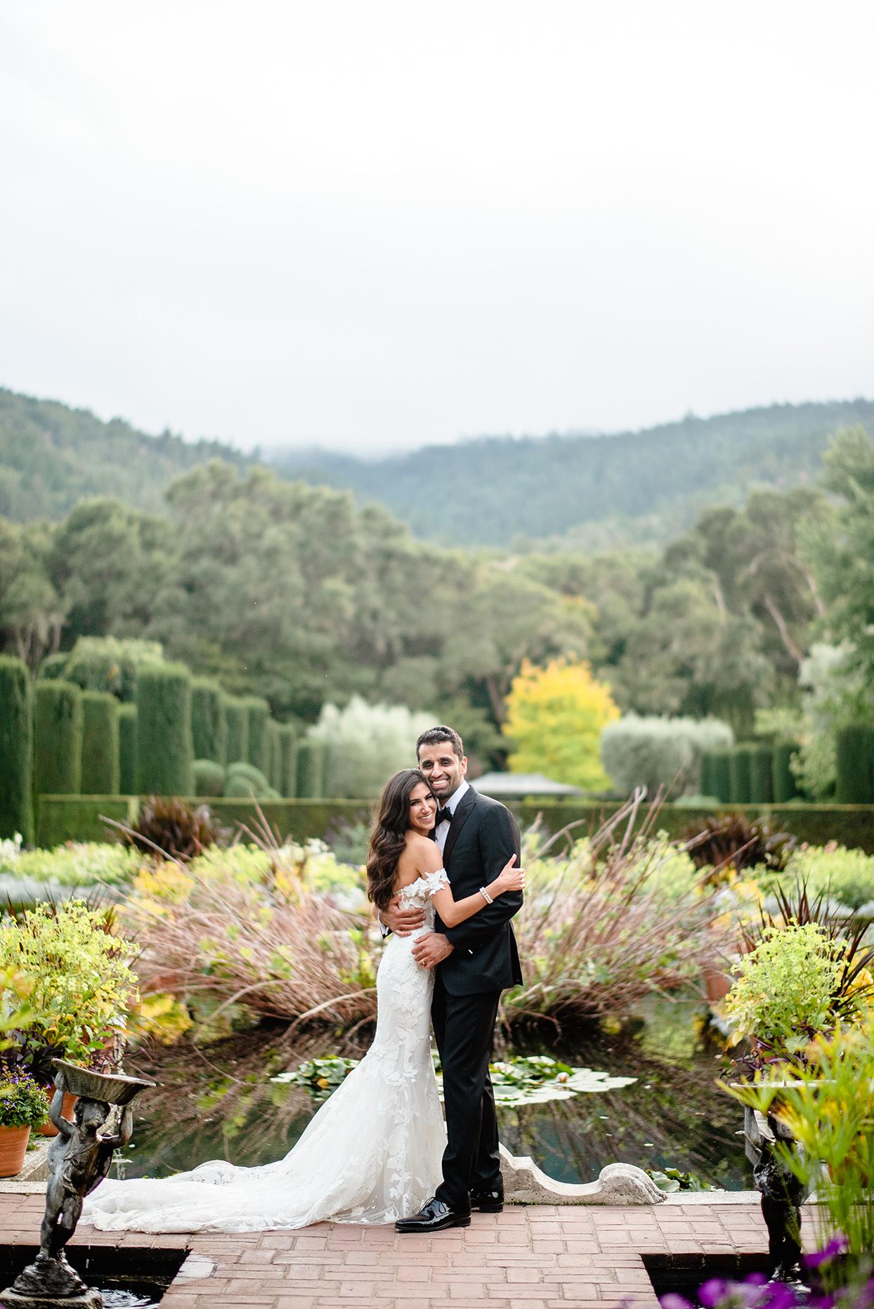 yalda anusha wedding couple portrait in garden venue overlooking hills