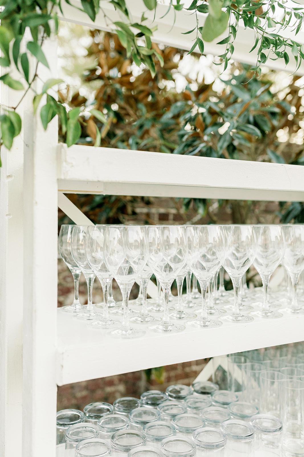 White shelving holding glasses