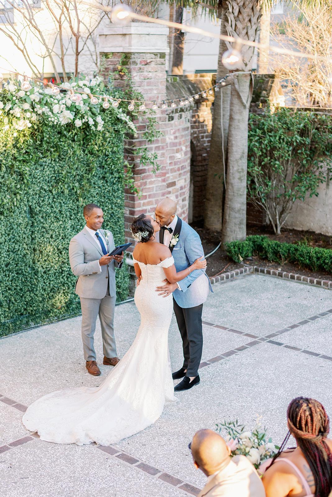 Couple getting married in ourdoor courtyard