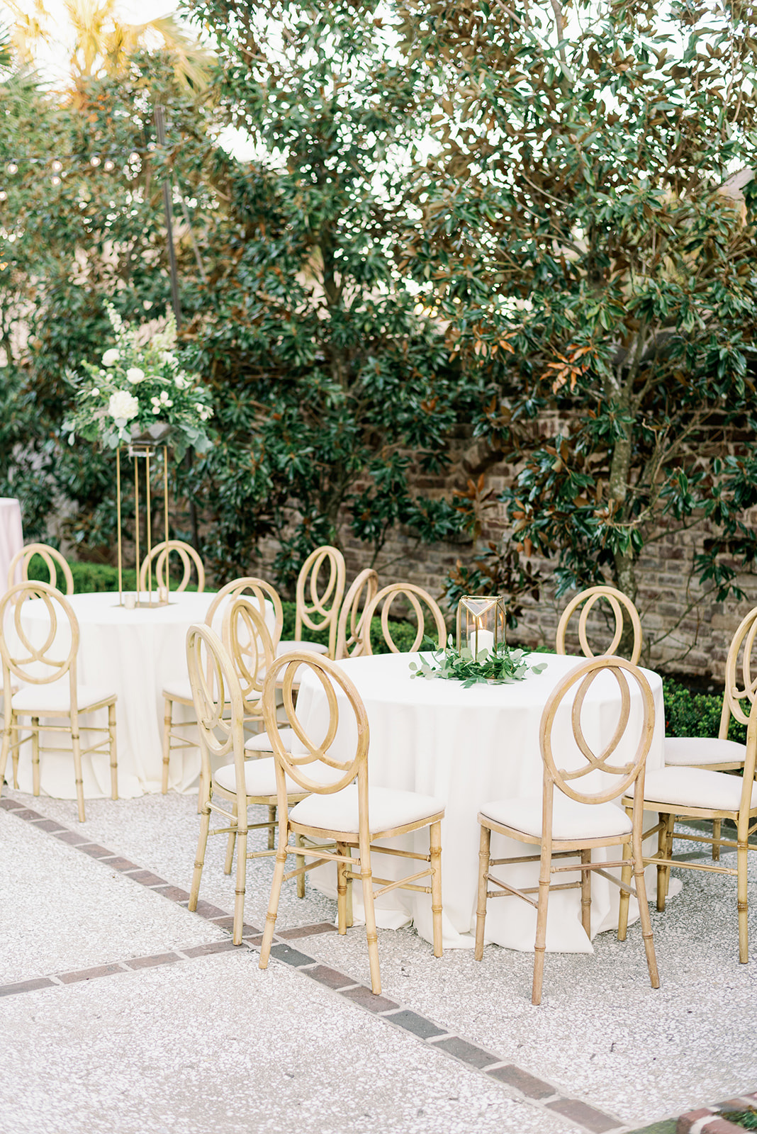 Round tables with simple greenery and petite lanterns