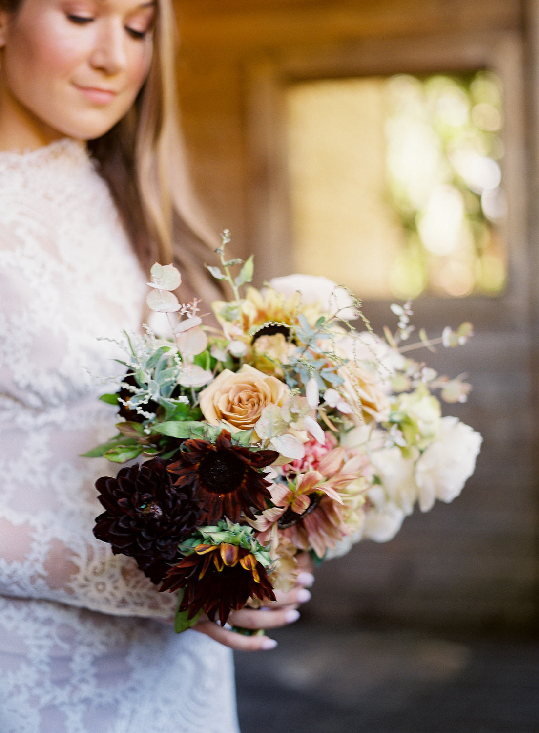 bianca holding warm tones bridal bouquet