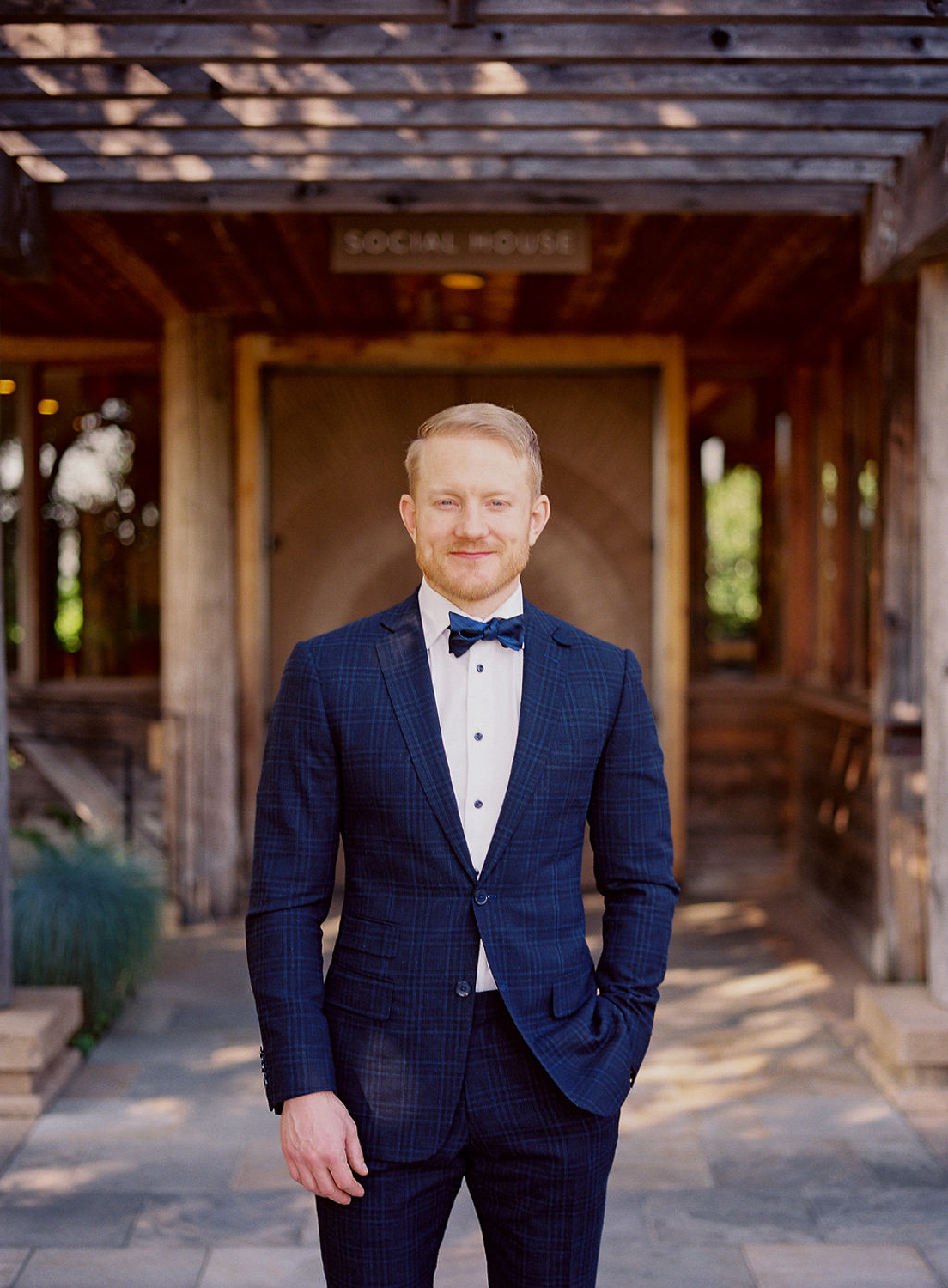 wedding groom in plaid blue suit