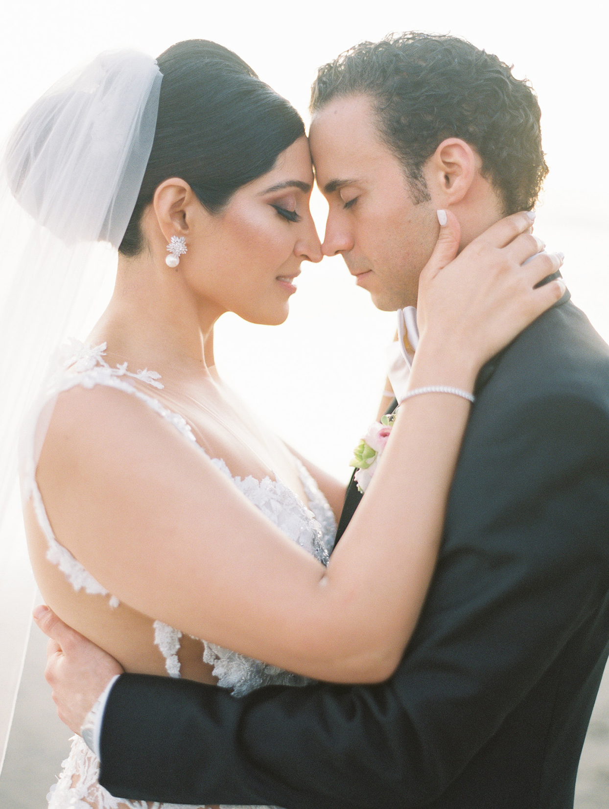 wedding couple embracing in close up portrait