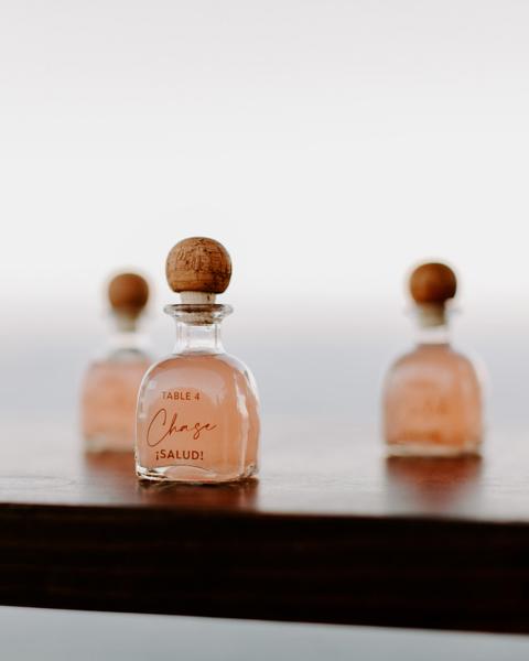 custom patron bottles as wedding escort cards