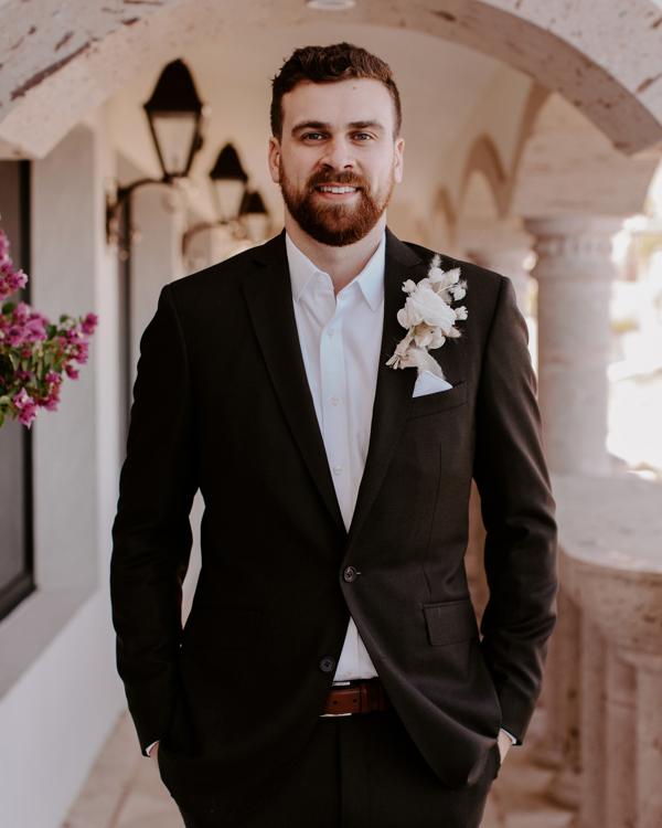 wedding groom in dark brown suit