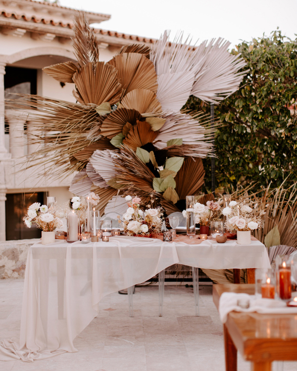 bohemian head table with flowers and candles