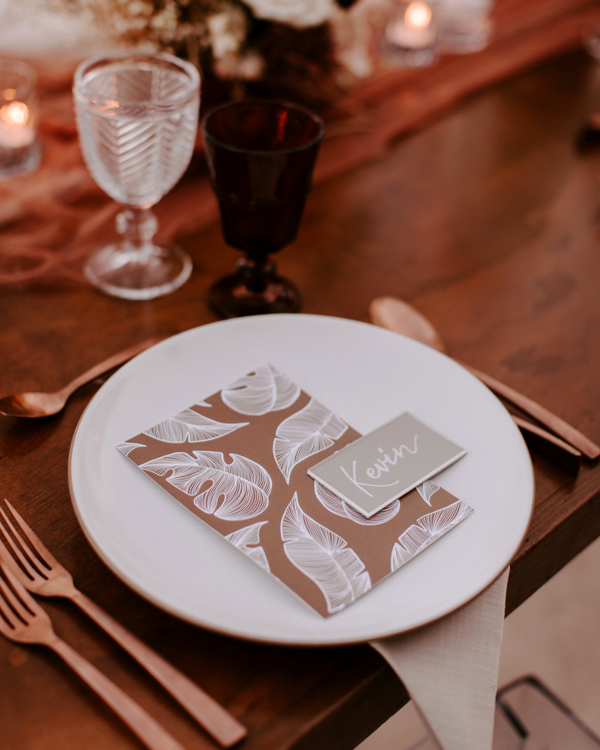 wedding reception place setting with leaf decor on place card