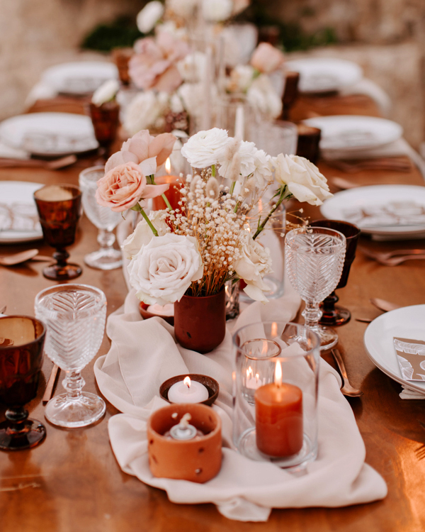 rustic bohemian runner on reception table with flowers and candles