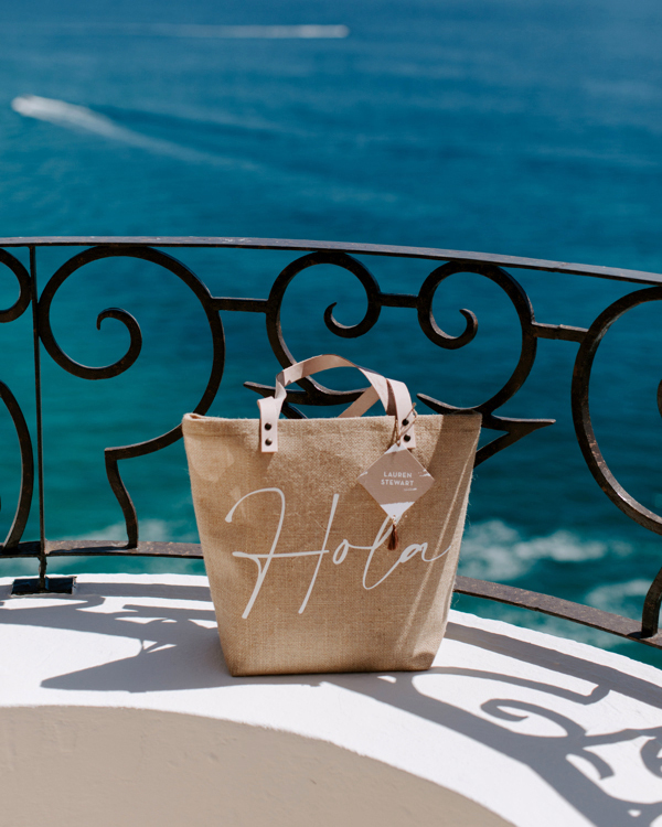 haylie kevin wedding welcome bag sitting on ledge overlooking water