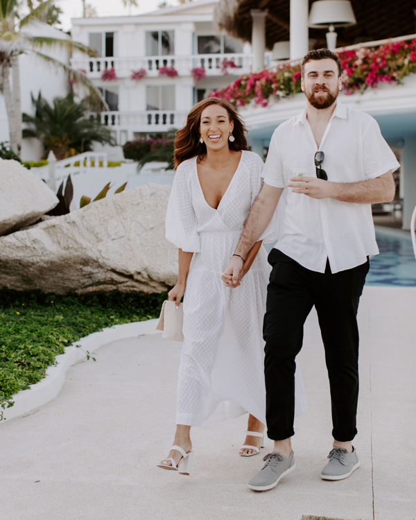 couple walking together into wedding welcome party