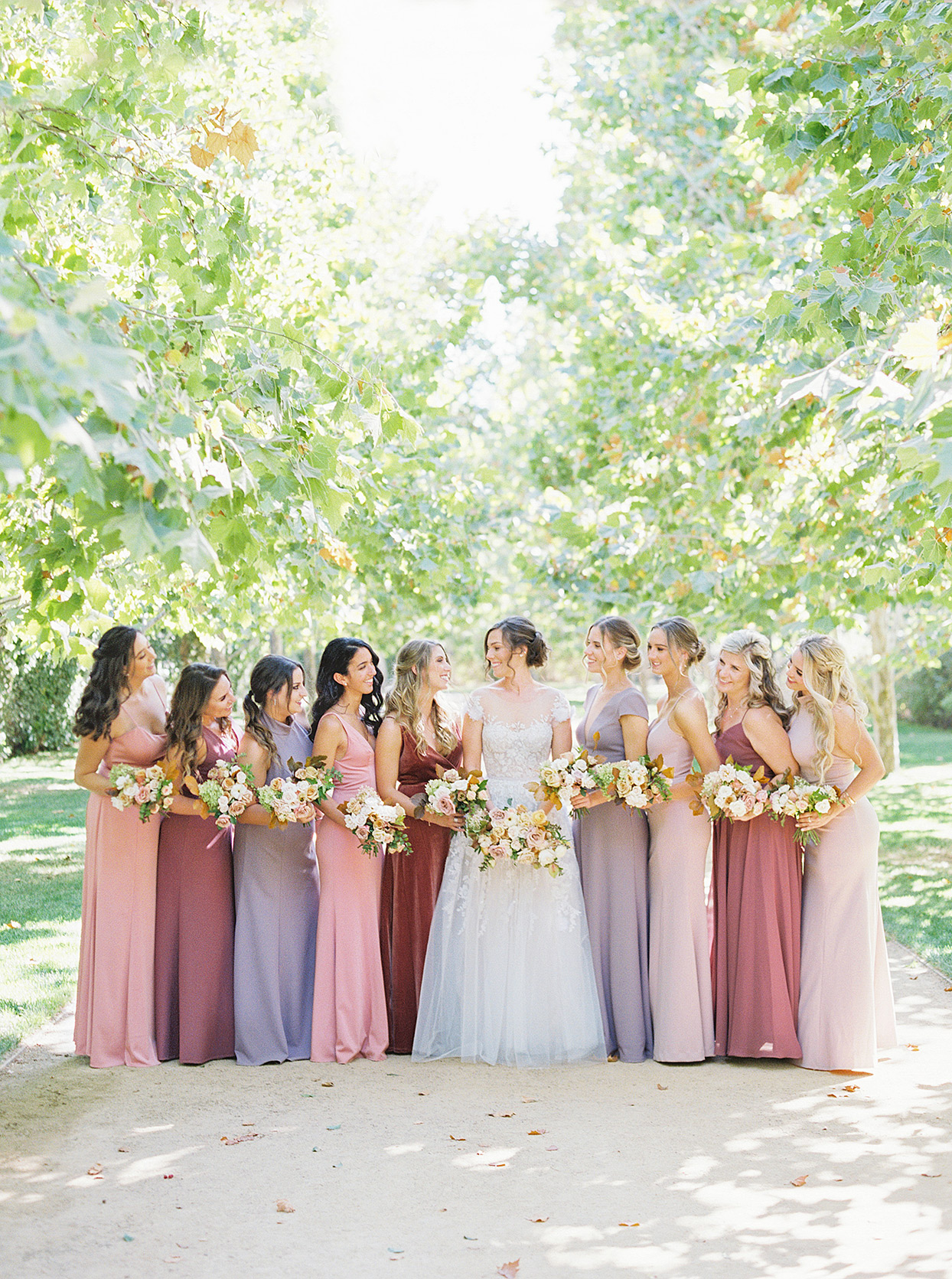 sam kyler wedding bridesmaids in pink and purple dresses