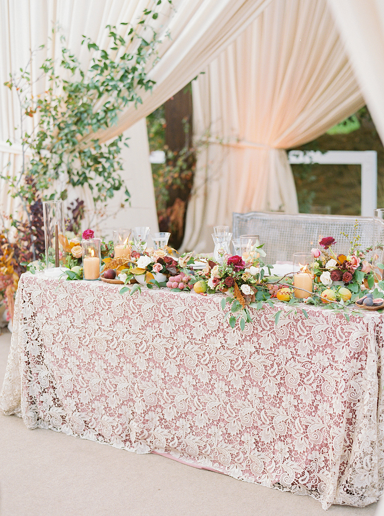 sweetheart table with lace cloth and rustic fall flowers