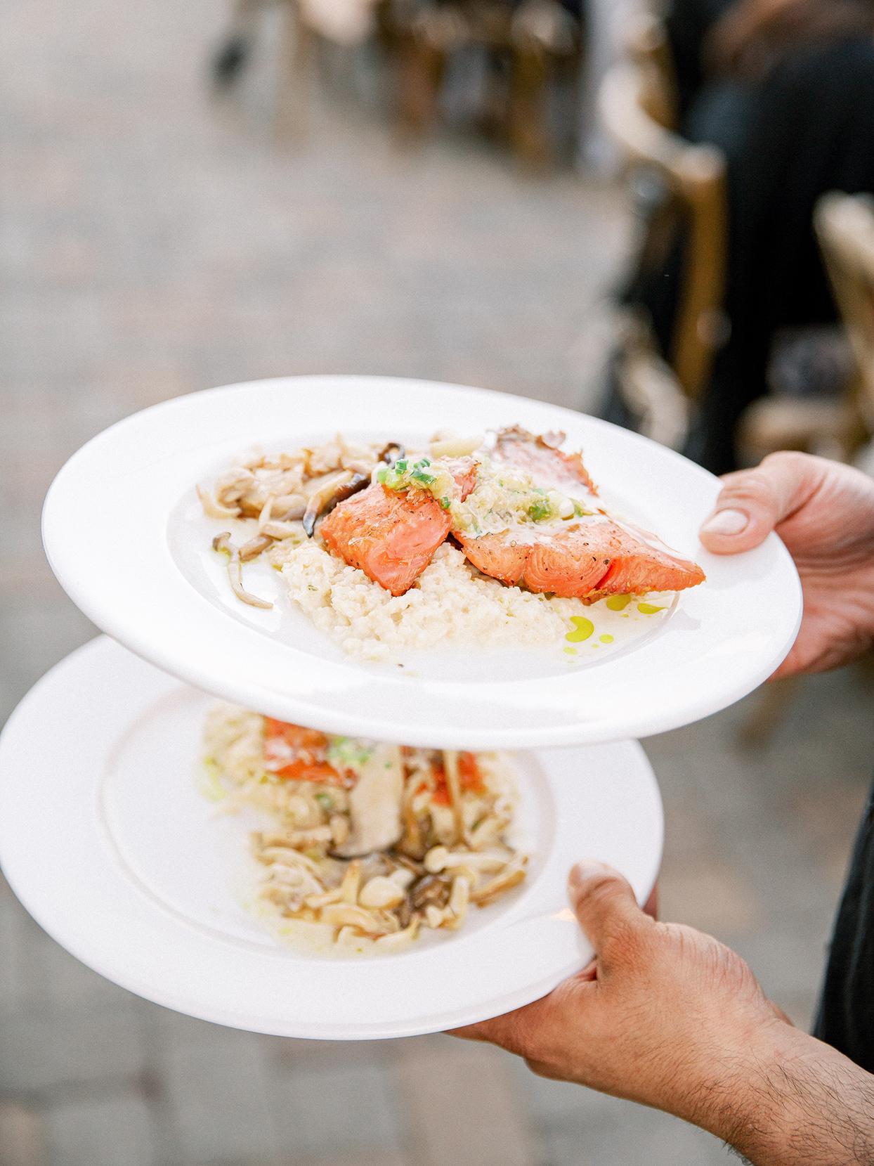 salmon dinner on white plates at rehearsal dinner