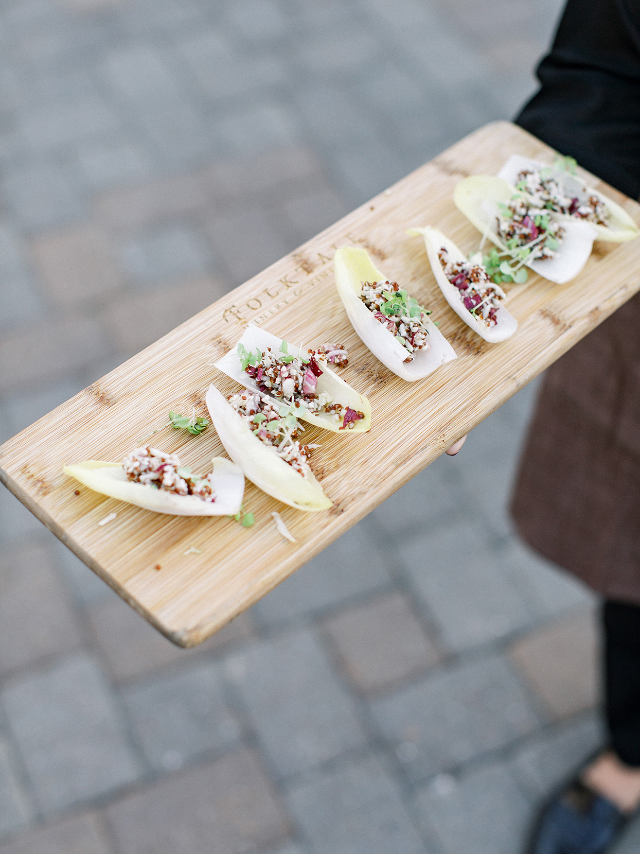rehearsal dinner appetizers on wooden tray