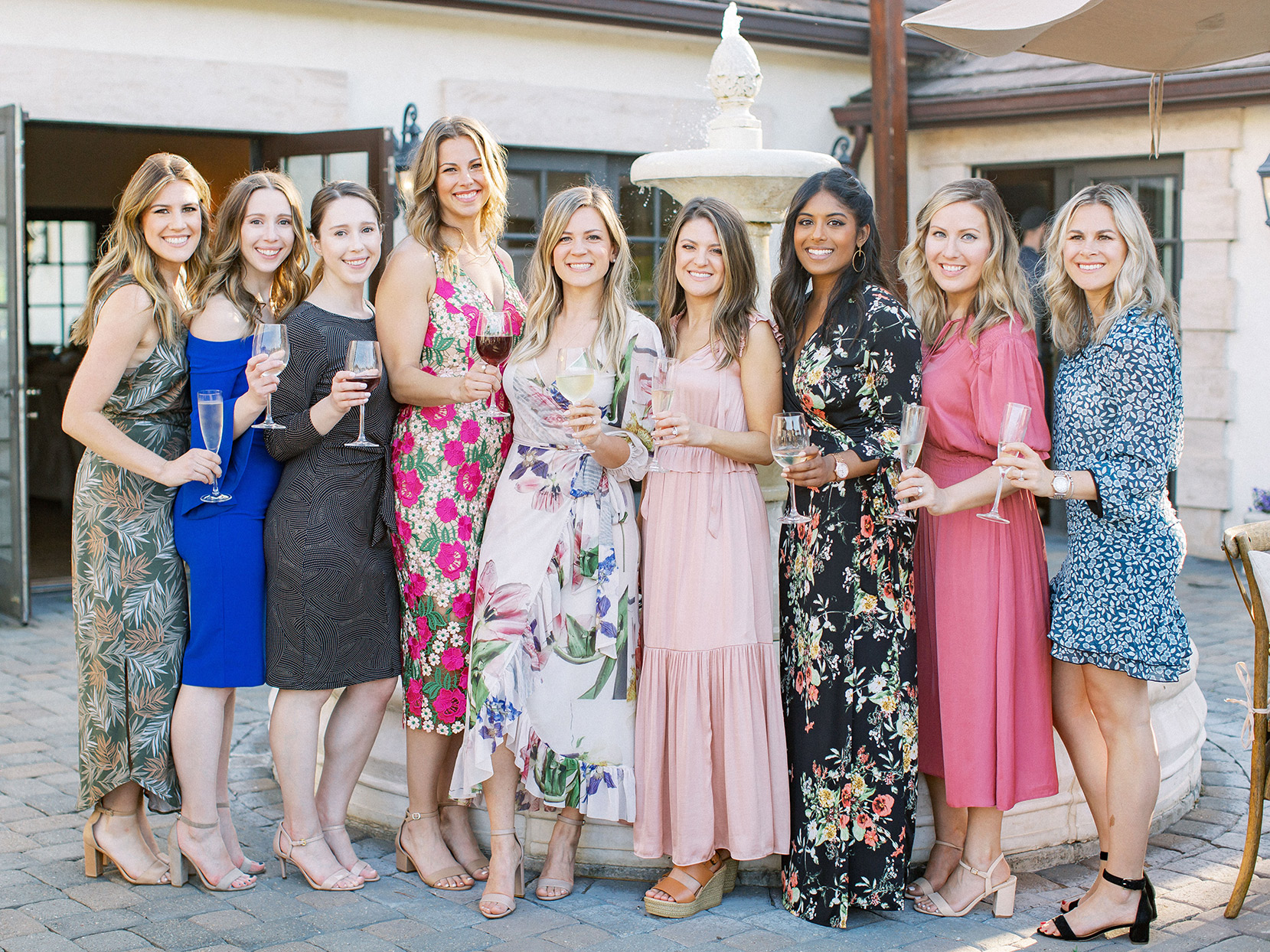 bride and friends in colorful dresses at rehearsal dinner
