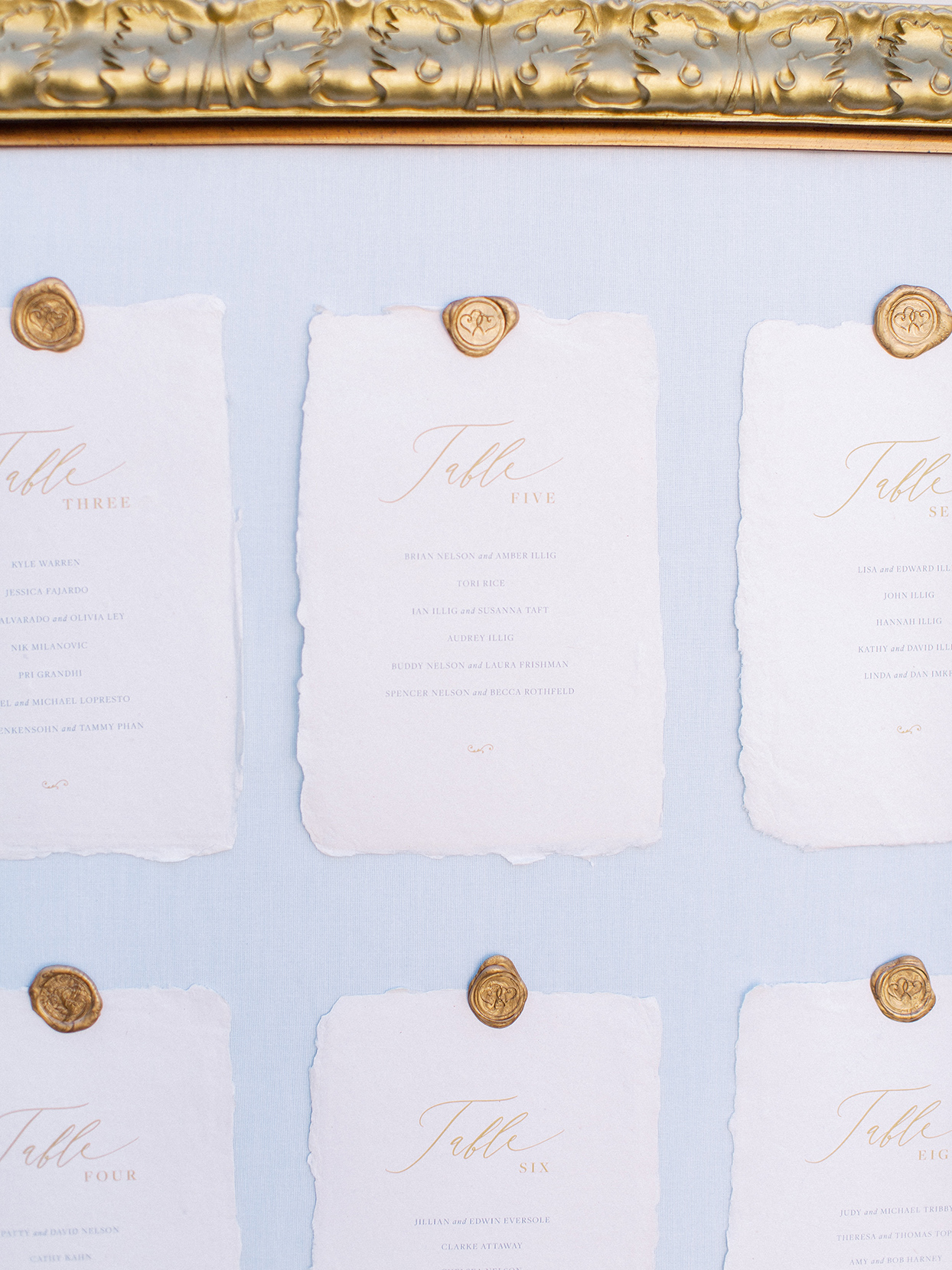 rustic ripped paper and golden seal seating chart
