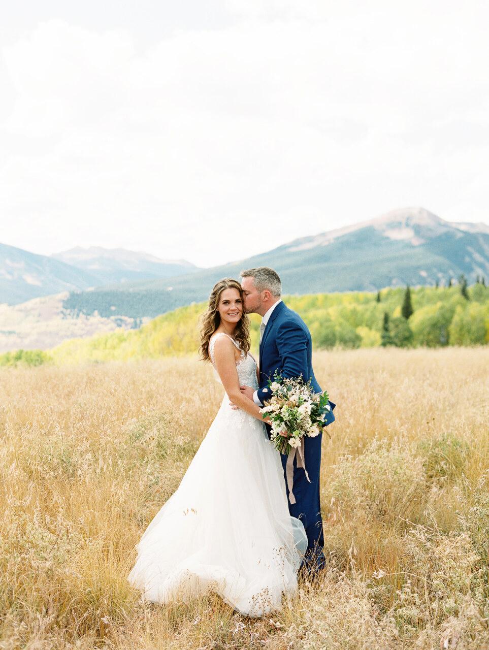 molly frank wedding couple in field