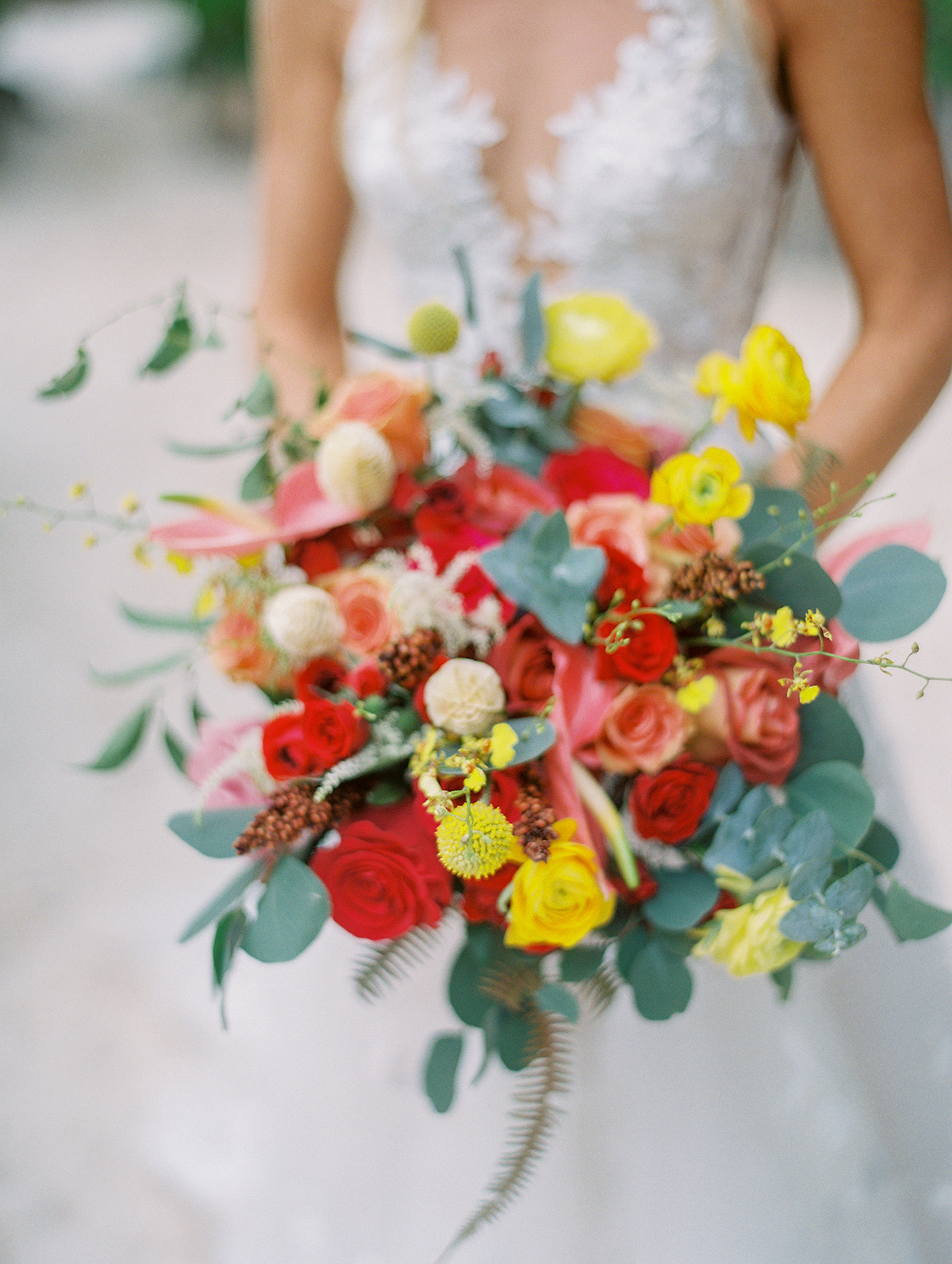 red and yellow floral wedding bouquet
