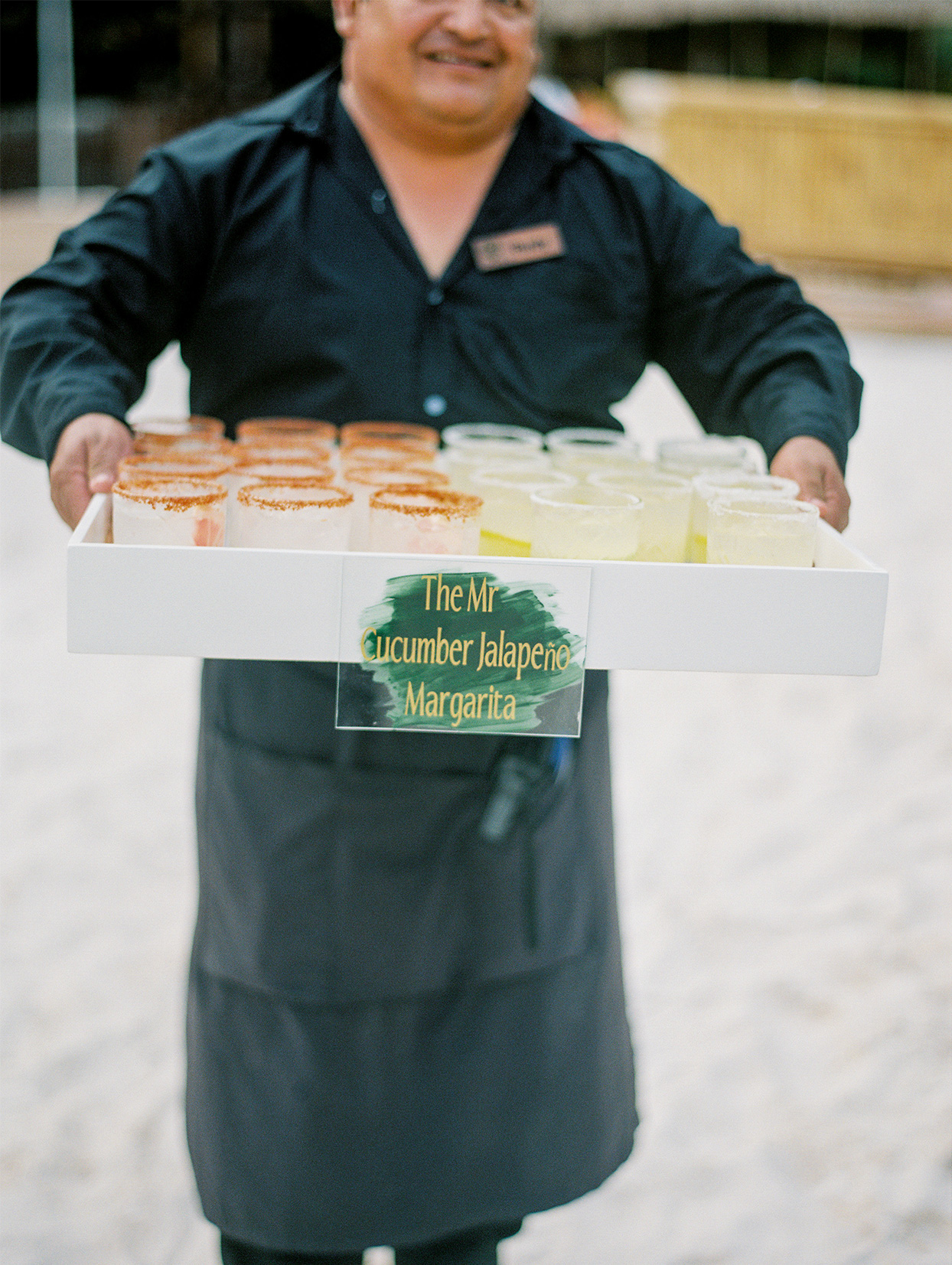 server holding tray of wedding margaritas