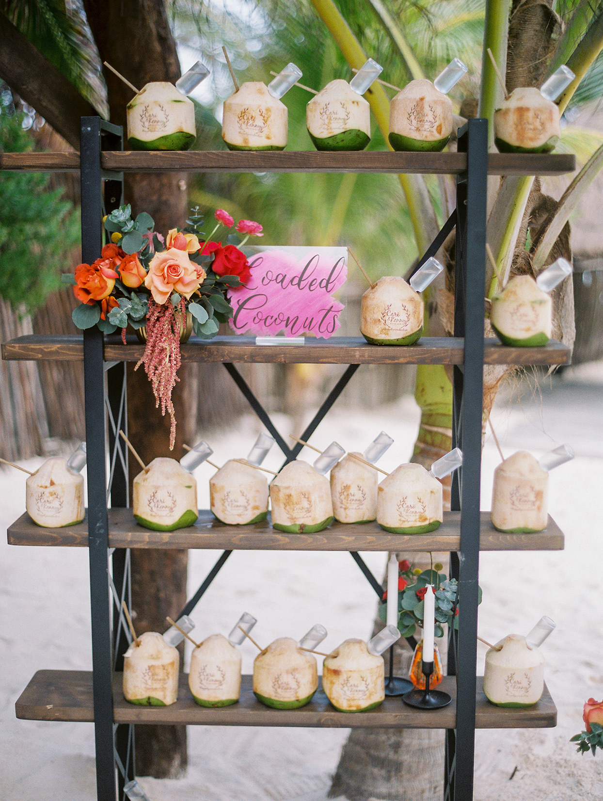 wedding coconuts printed with couples names on wooden stand
