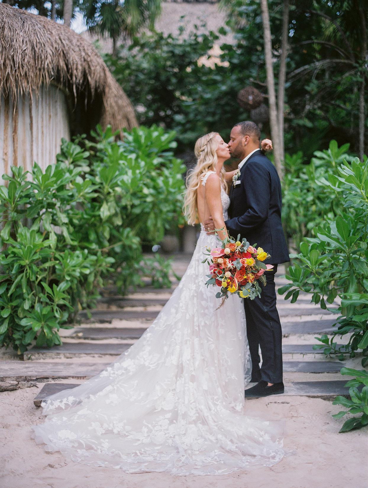 wedding couple kissing on sandy boardwalk
