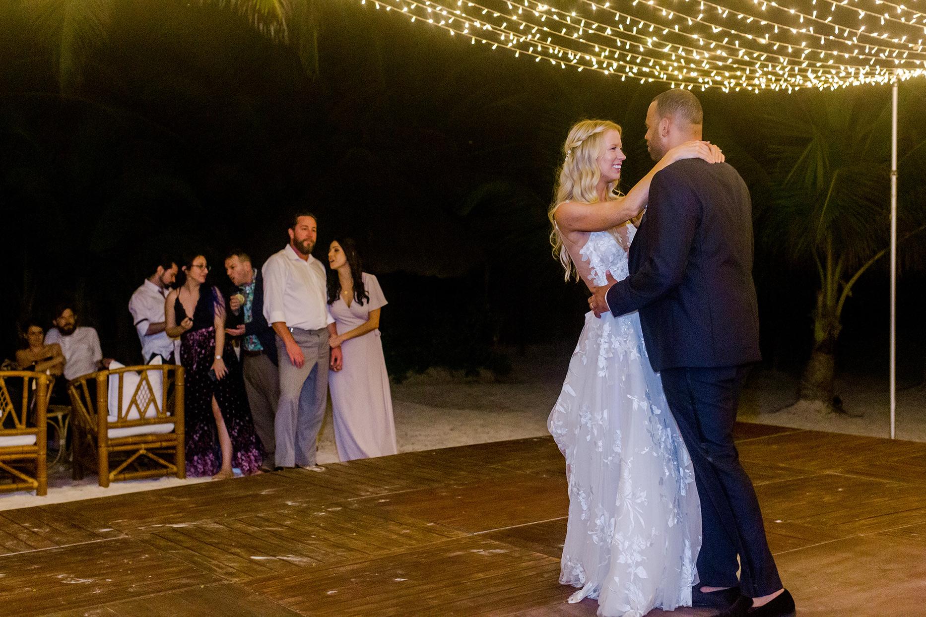 wedding couple first dance on beach reception floor