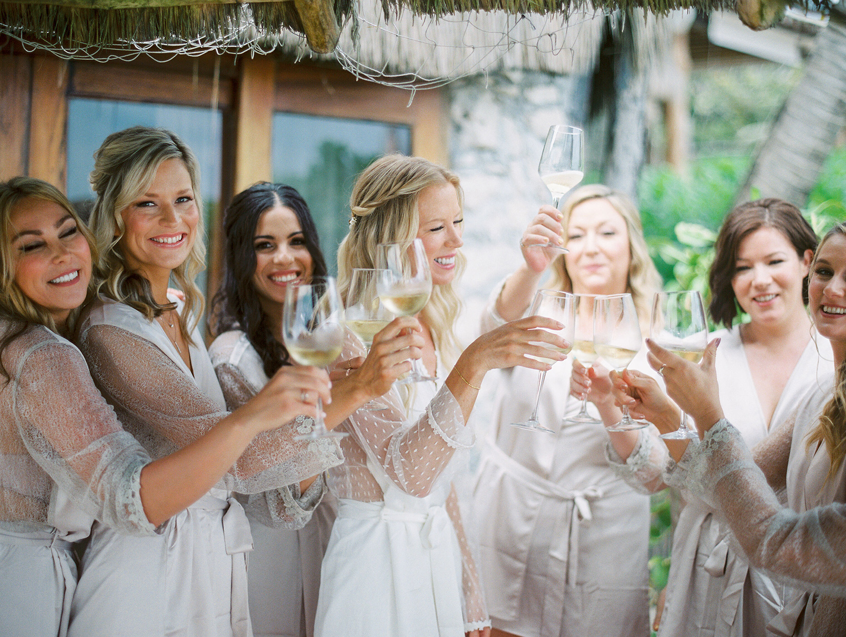 wedding bridal party getting ready and toasting white