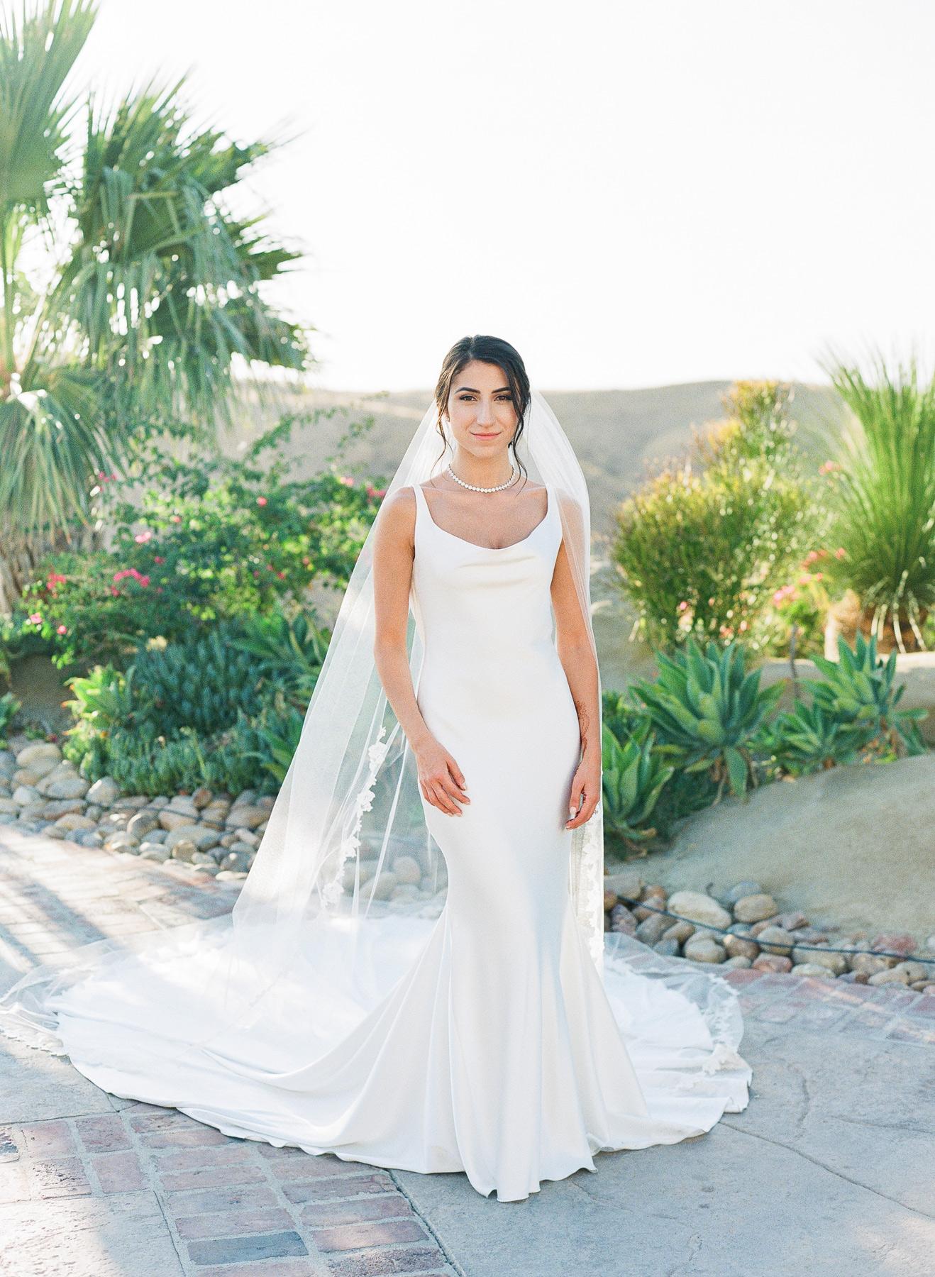 outdoor portrait Sasha in traditional white wedding dress