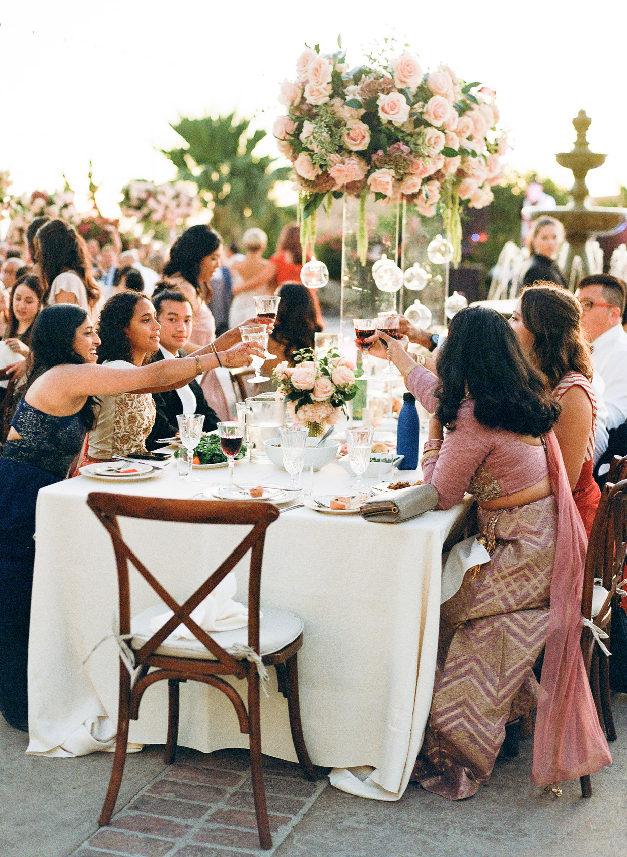 guests at reception table wedding cheers