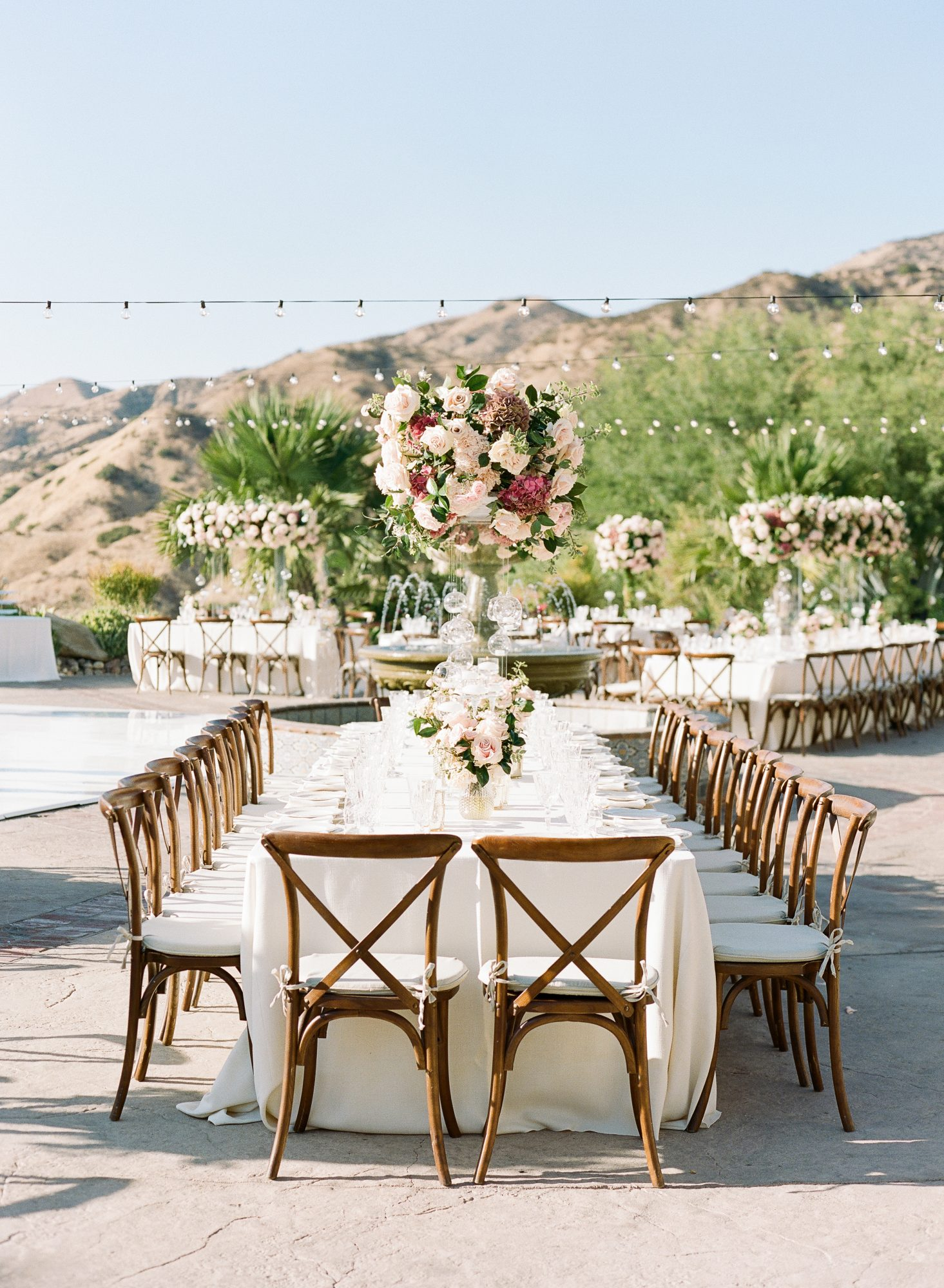 reception tables with large floral centerpieces