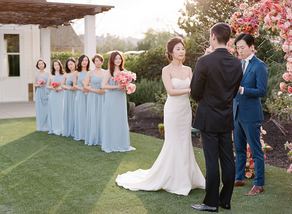 couple holding hands during outdoor wedding ceremony