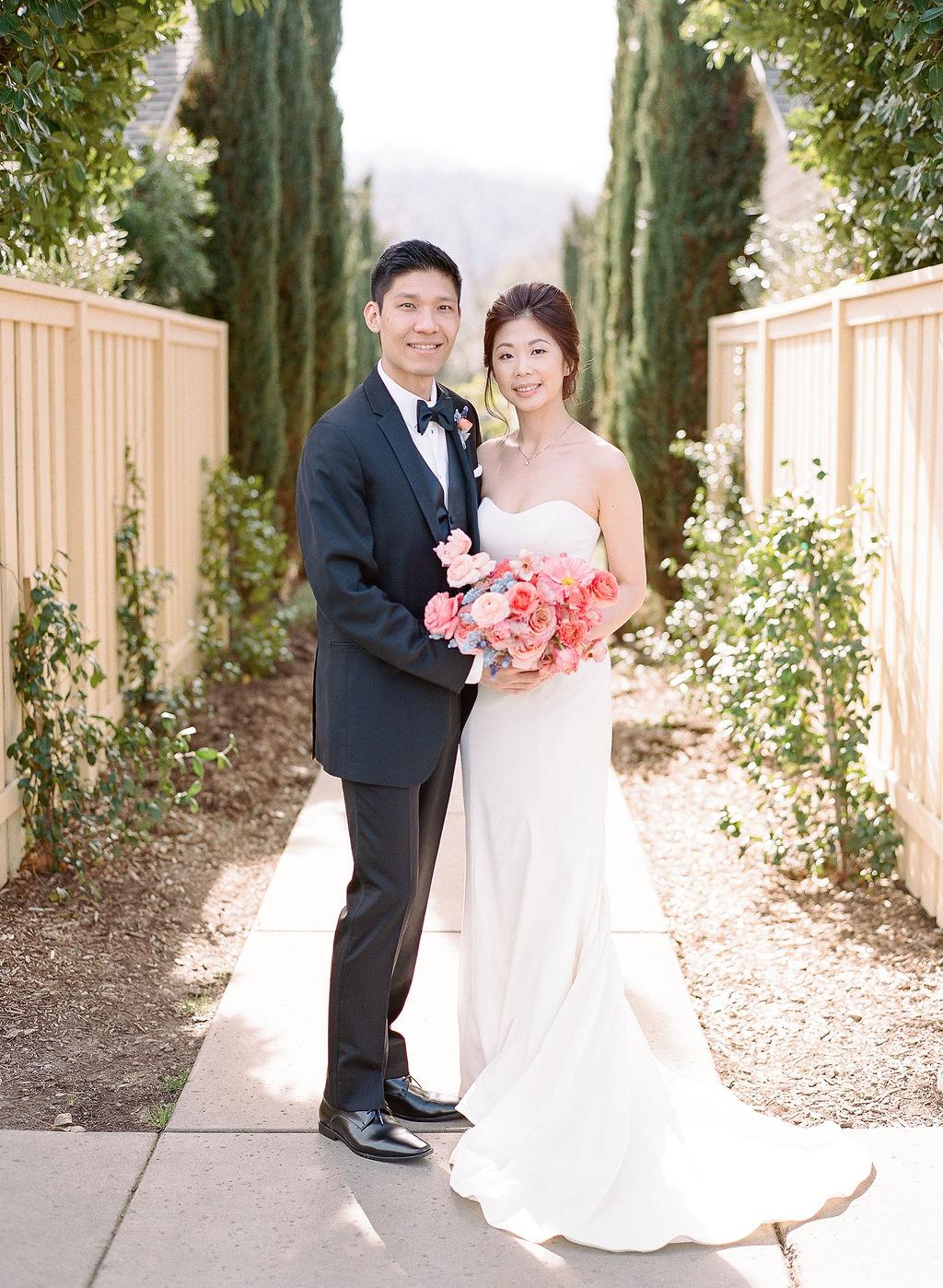wedding couple portrait on garden walkway
