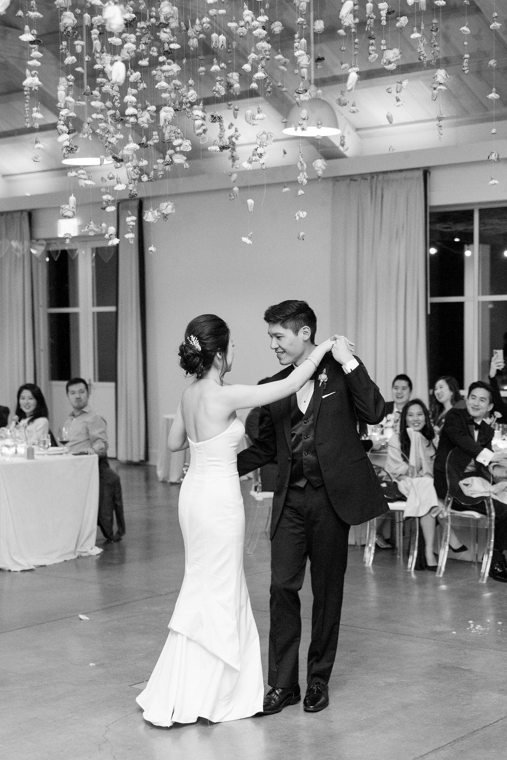 couple wedding first dance under hanging valentine decor