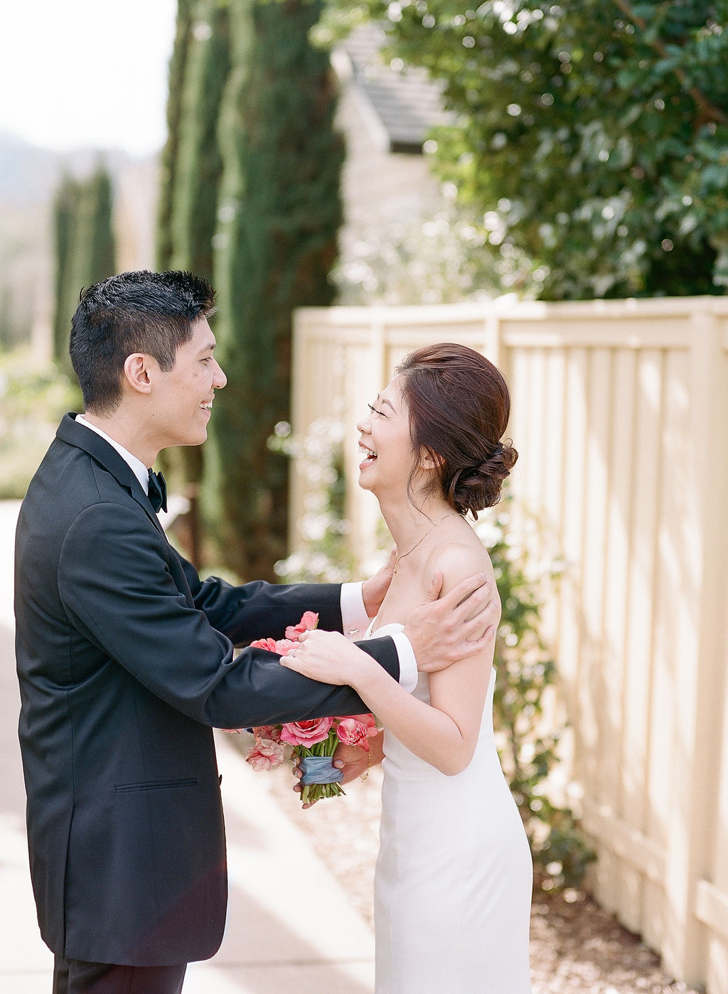 couple smiling during first look outdoors