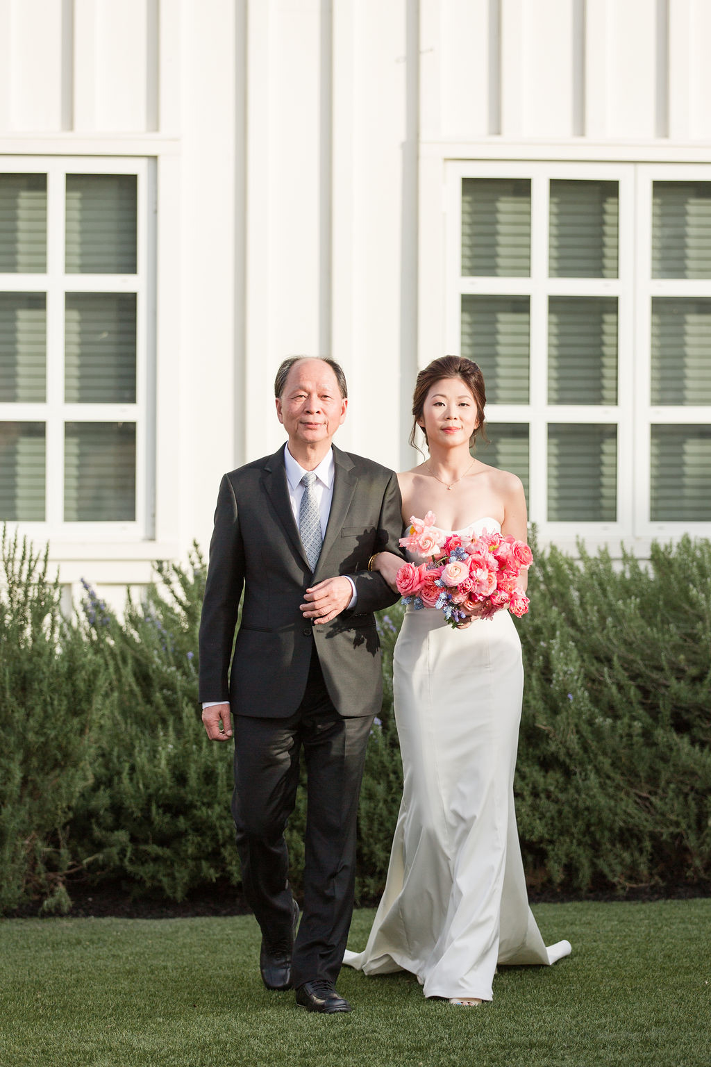bride and father processing in outdoor garden wedding