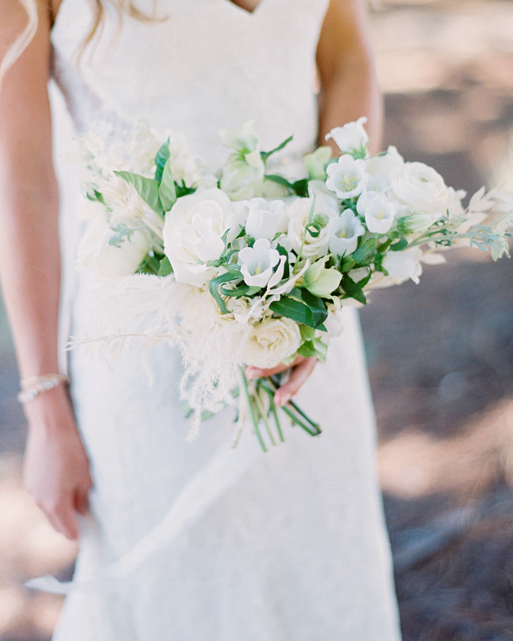 crescent-shaped bouquet white green blooms